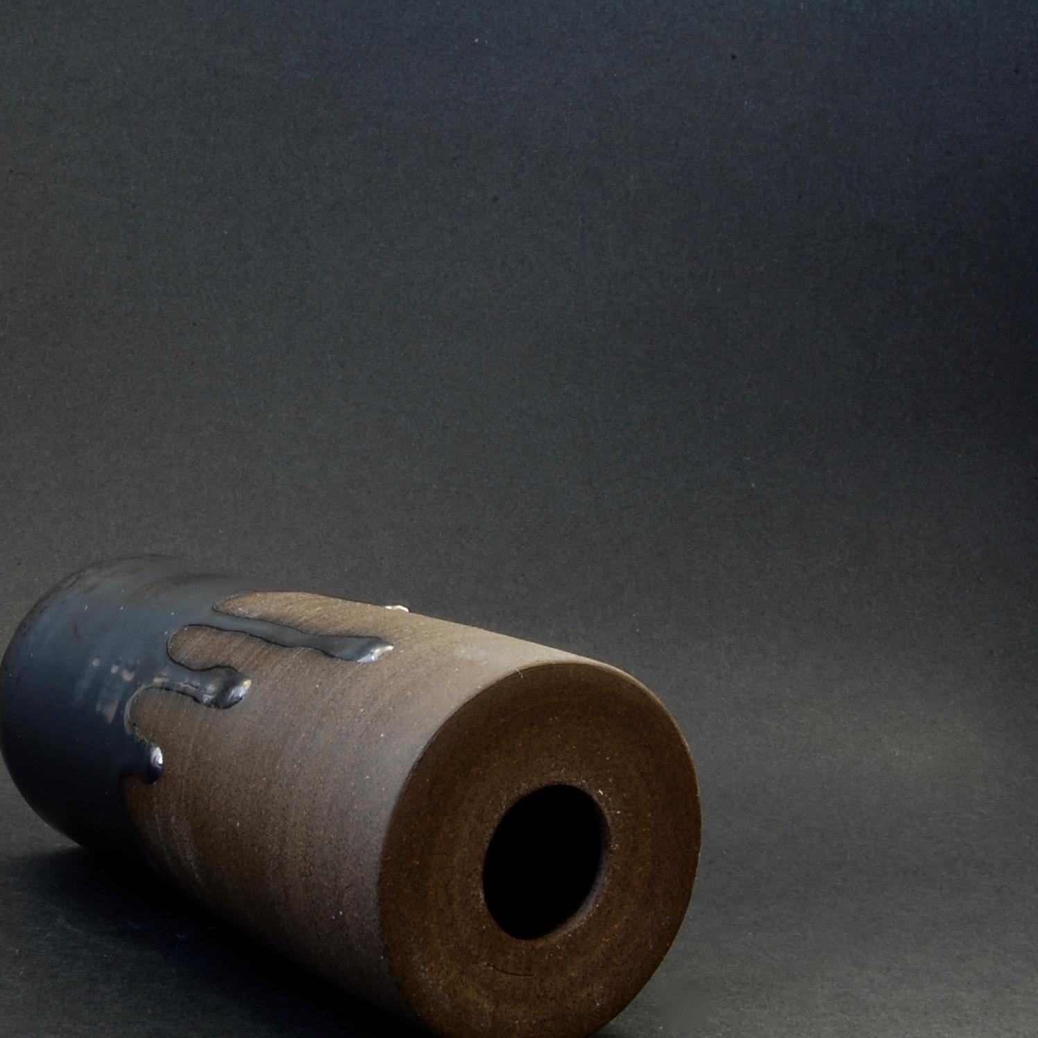 dark brown flat top vase on its side.jpg
