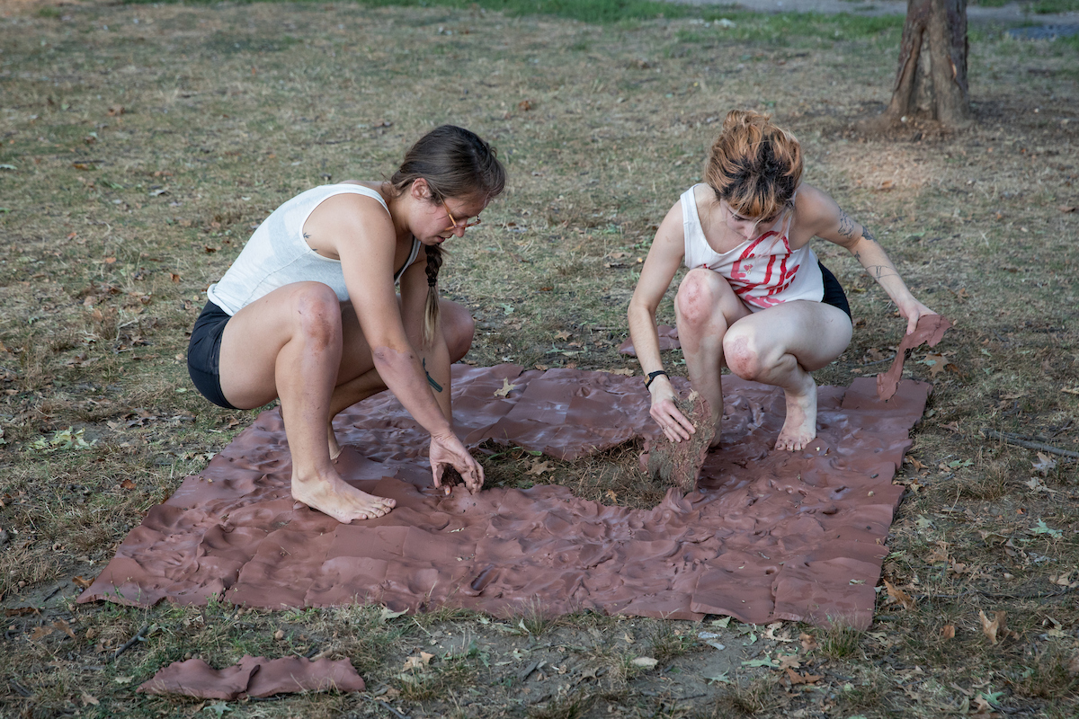 We tore up the pieces, trapping ourselves in a circle of clay. The pieces collected dirt, grass, acorns, and sticks.