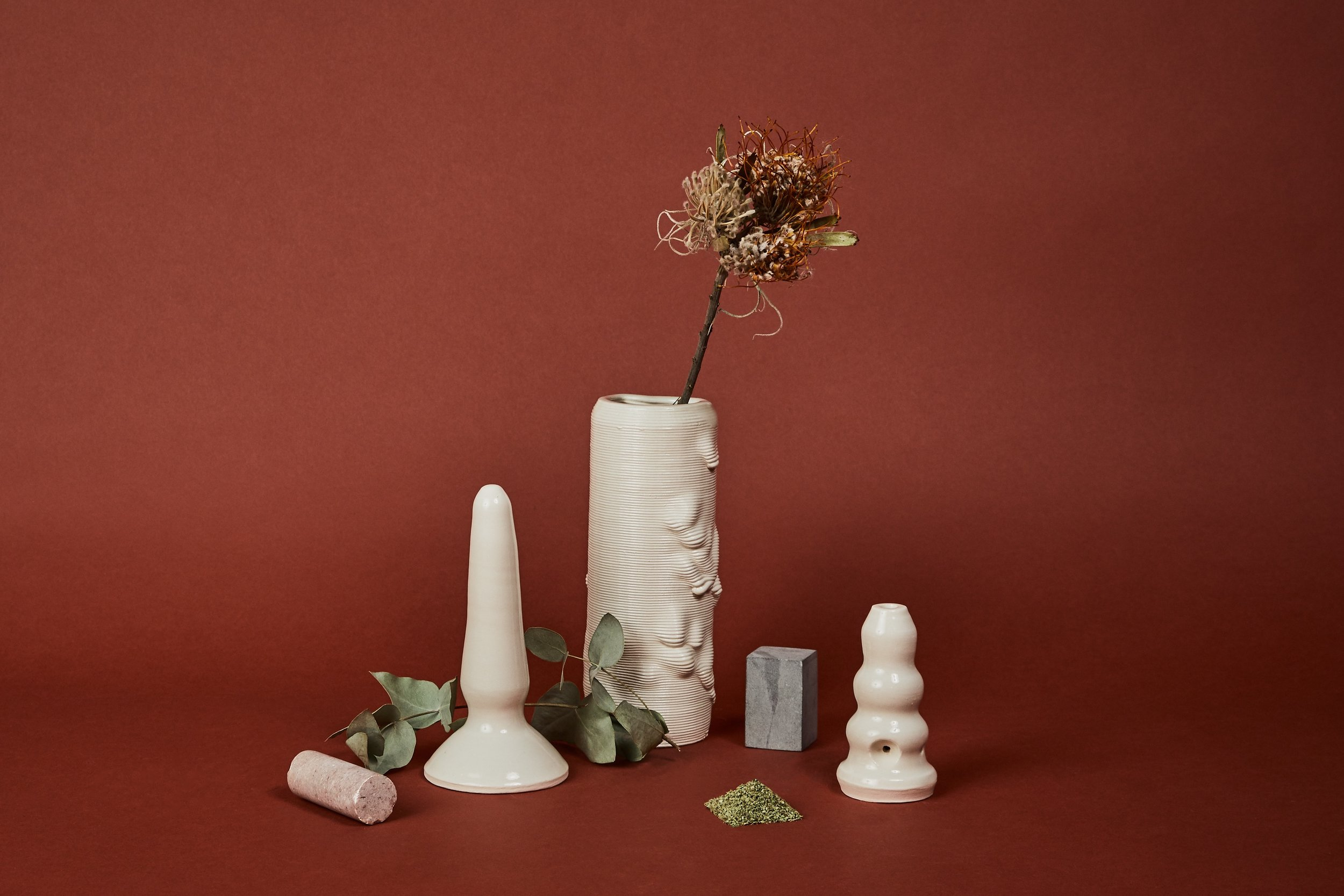 Left to right: unicorn, 3D printed vase, sculptural pipe.