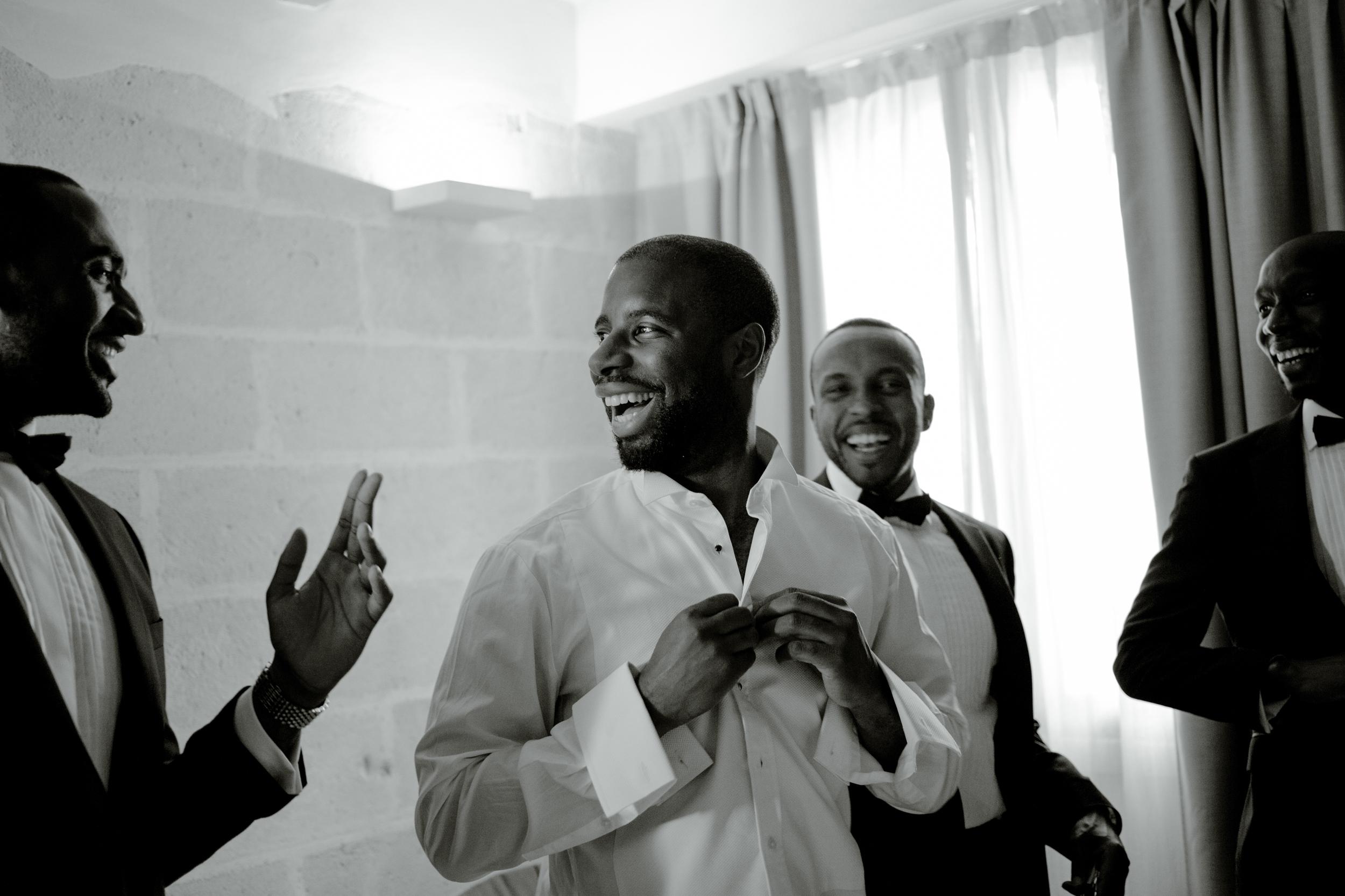 groom-getting-ready-with-groomsmen.jpg