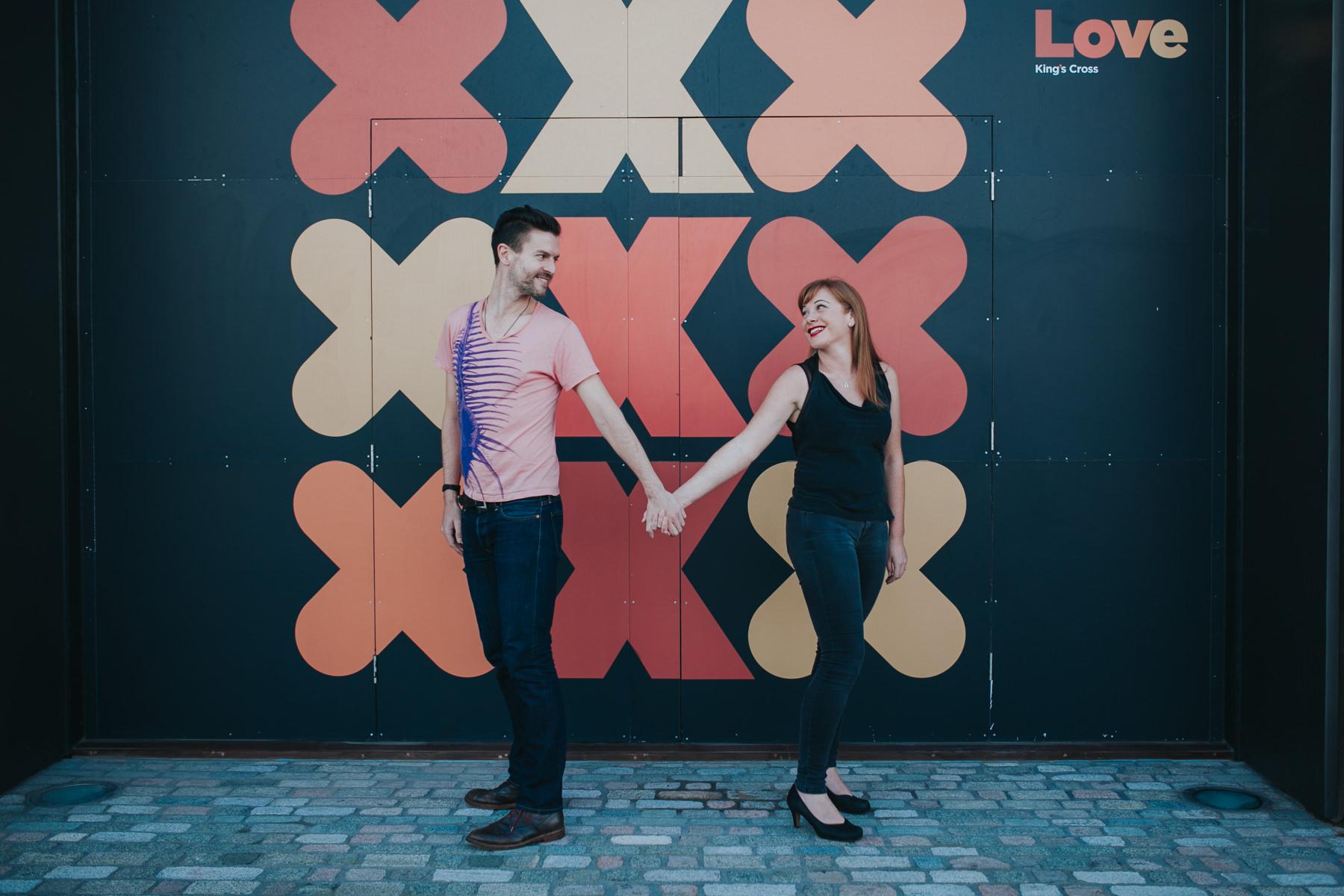 graphic-crosses-background-London-engagement-session-Kings-Cross-couple-portraits