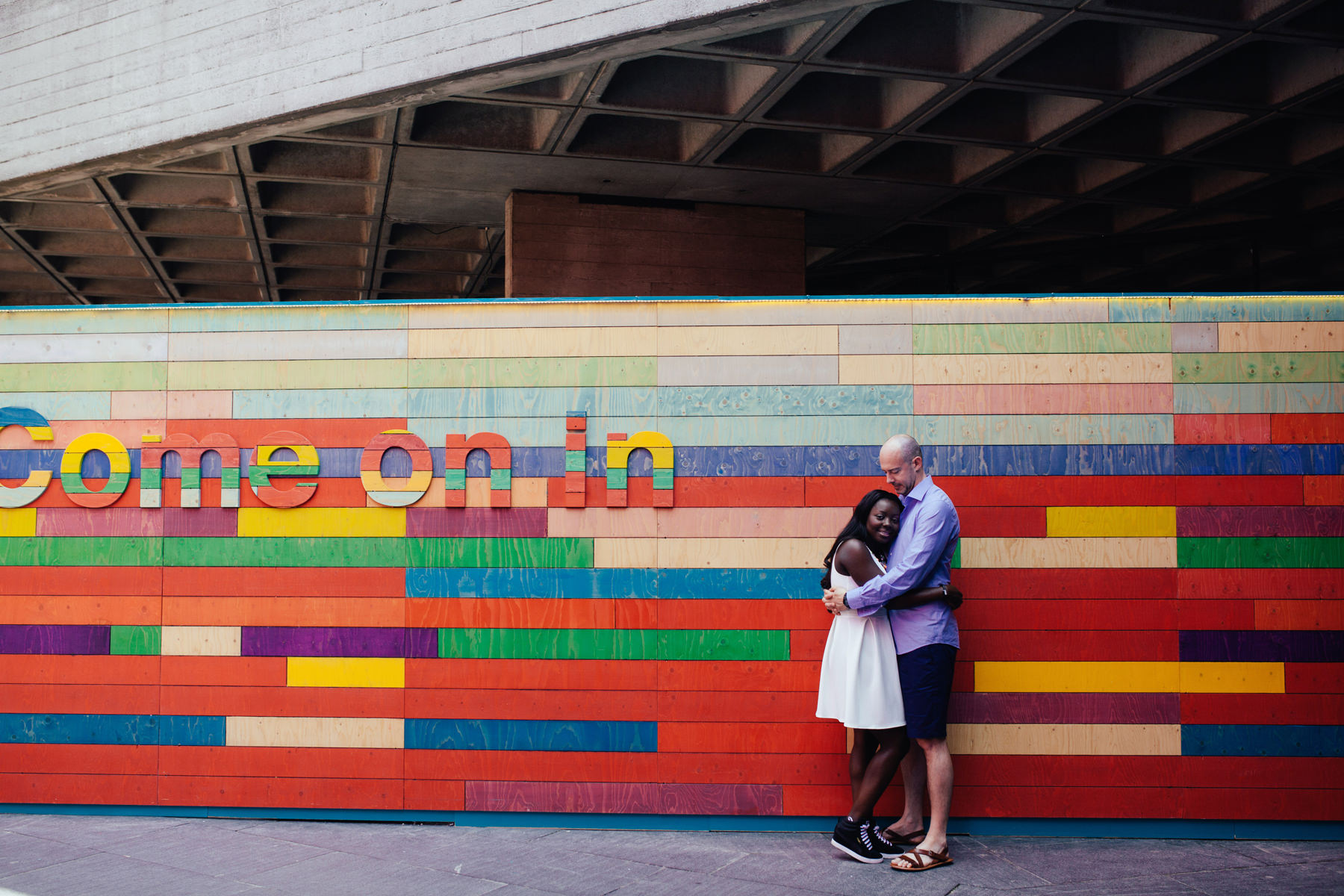 London Southbank engagement photographer couple portraits colourful background