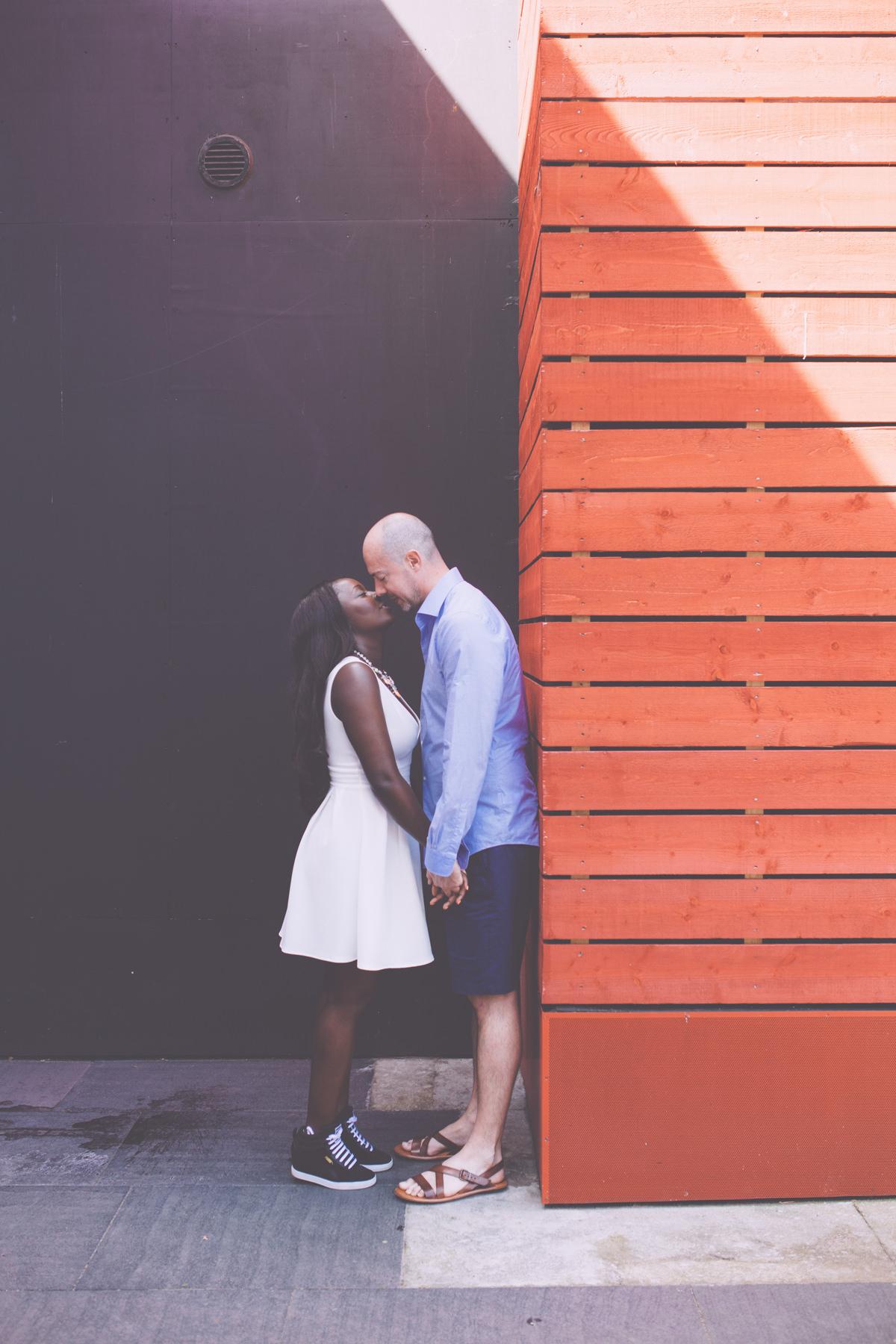 London-Southbank-engagement-photographer-couple-kissing