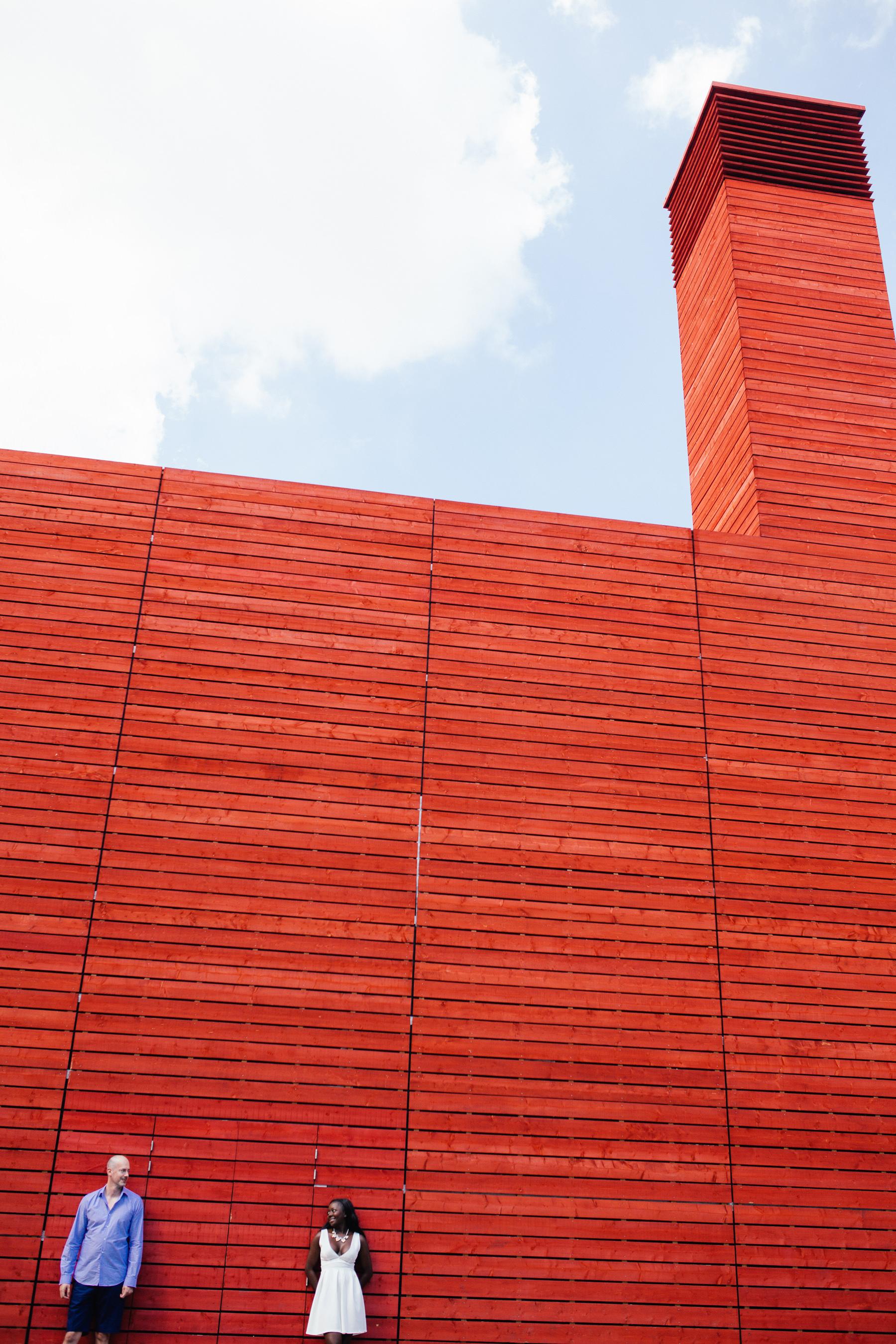 London-alternative-wedding-photographer-Southbank-engagement-photographer-against-big-red-wooden-background