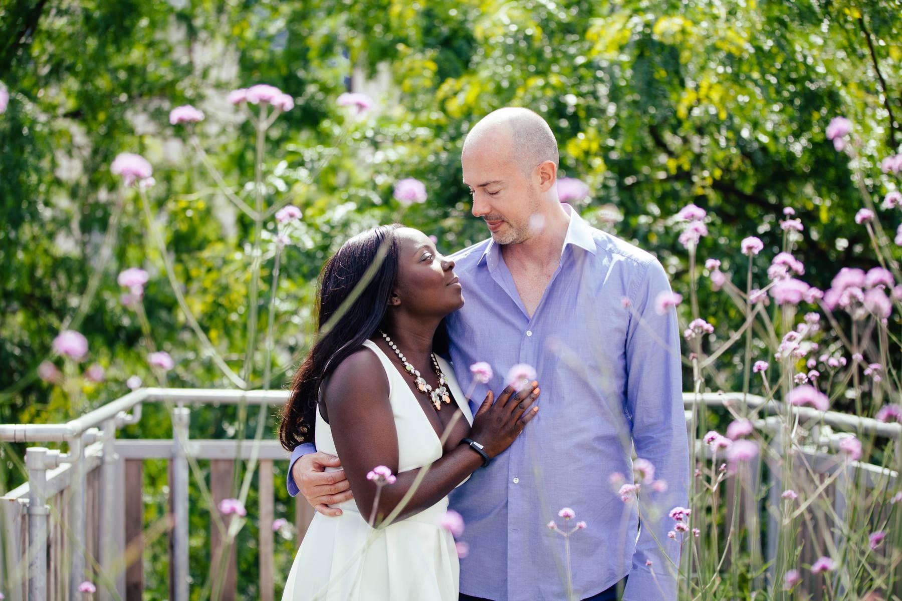 London-Southbank-engagement-photos-couple-embracing-amongst-flowers