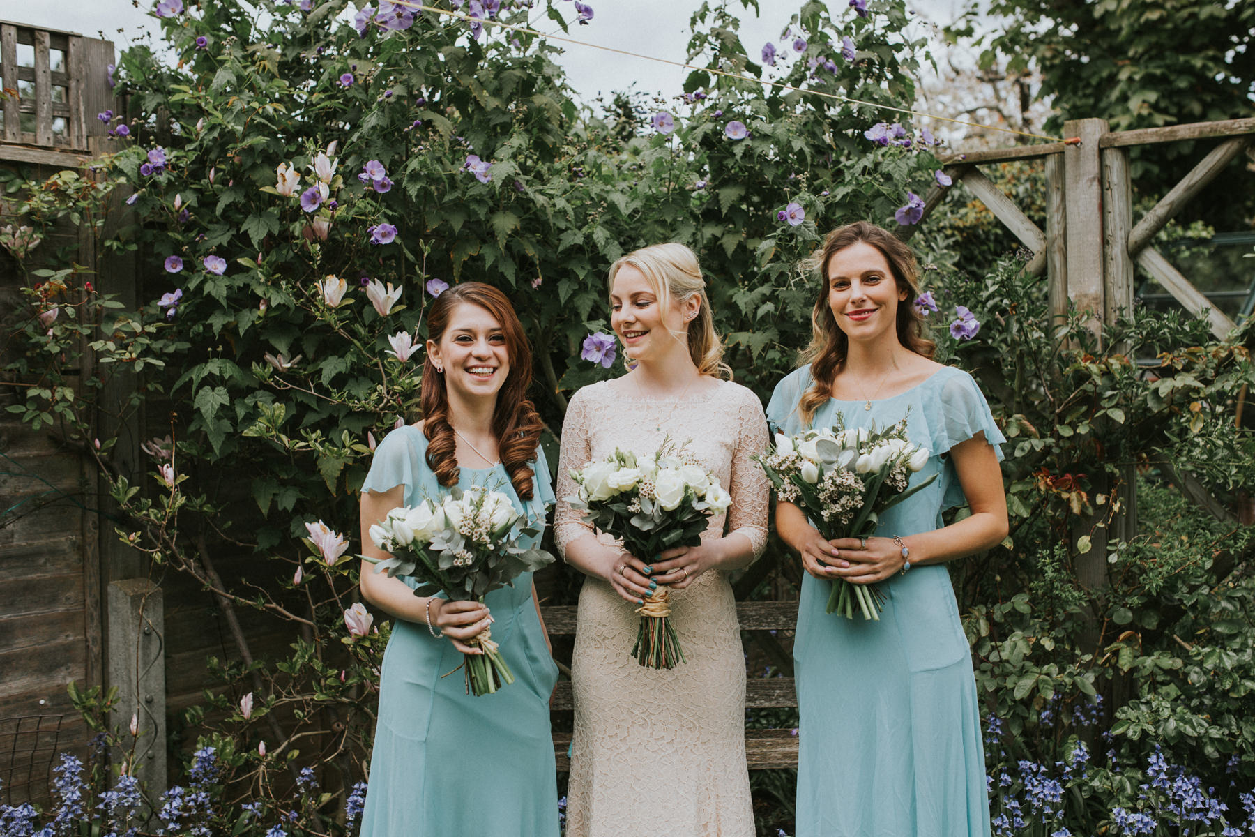 LD-90-bride-blush-lace-dress-bridesmaids-blue-dress-london-alternative-wedding-photographer.jpg