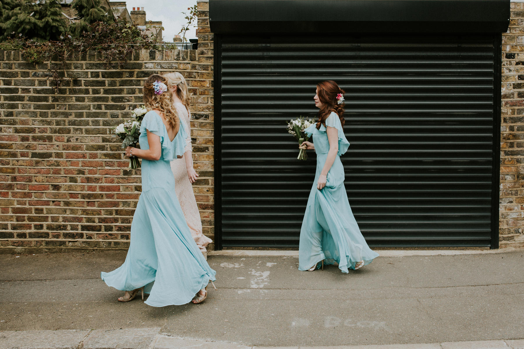 LD-131-London-bridesmaids-blue-dresses-bride-walking-to-wedding-ceremony.jpg