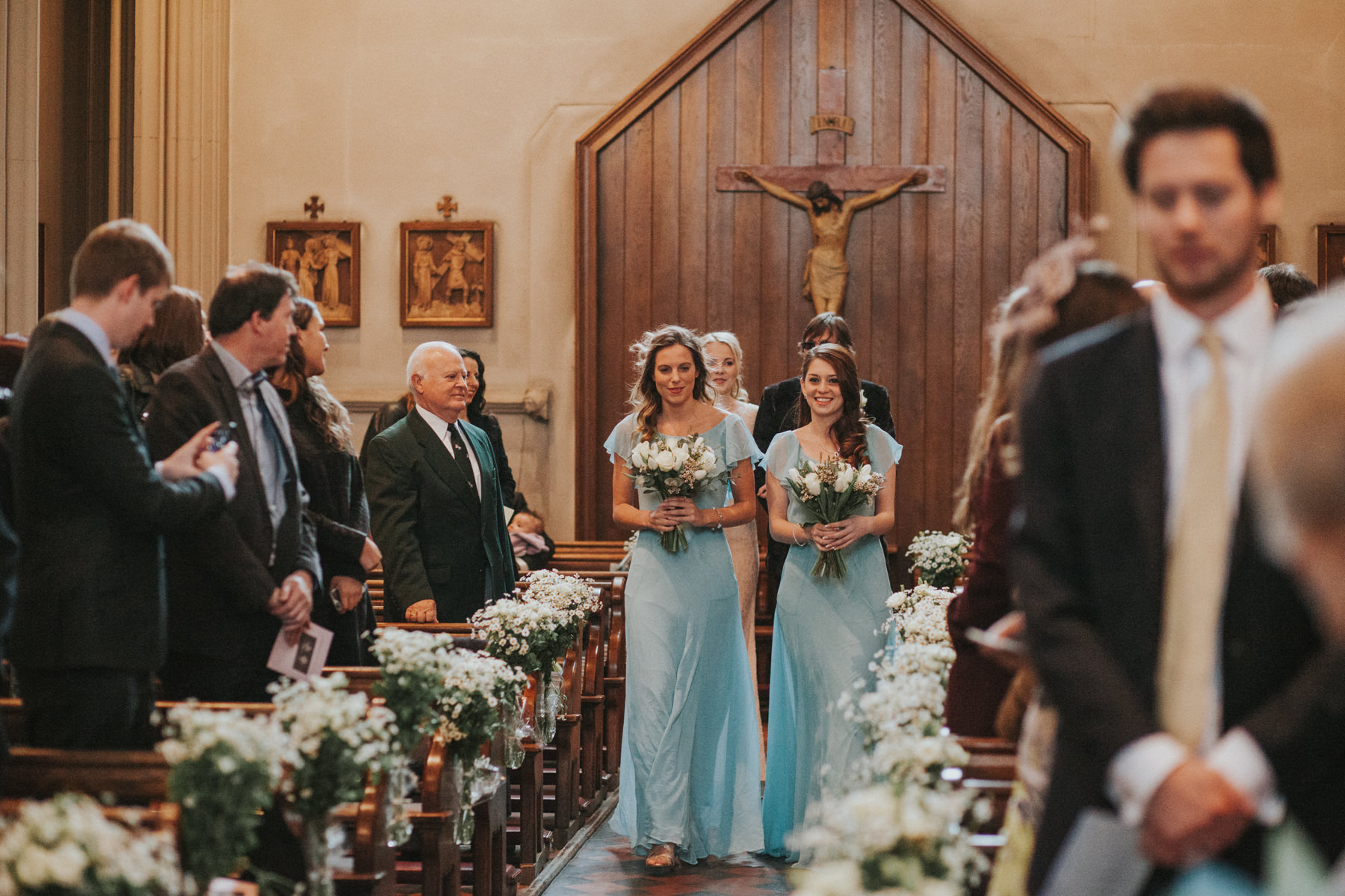 LD-168-bridesmaids-walking-down-aisle-clapham-common-catholic-church.jpg