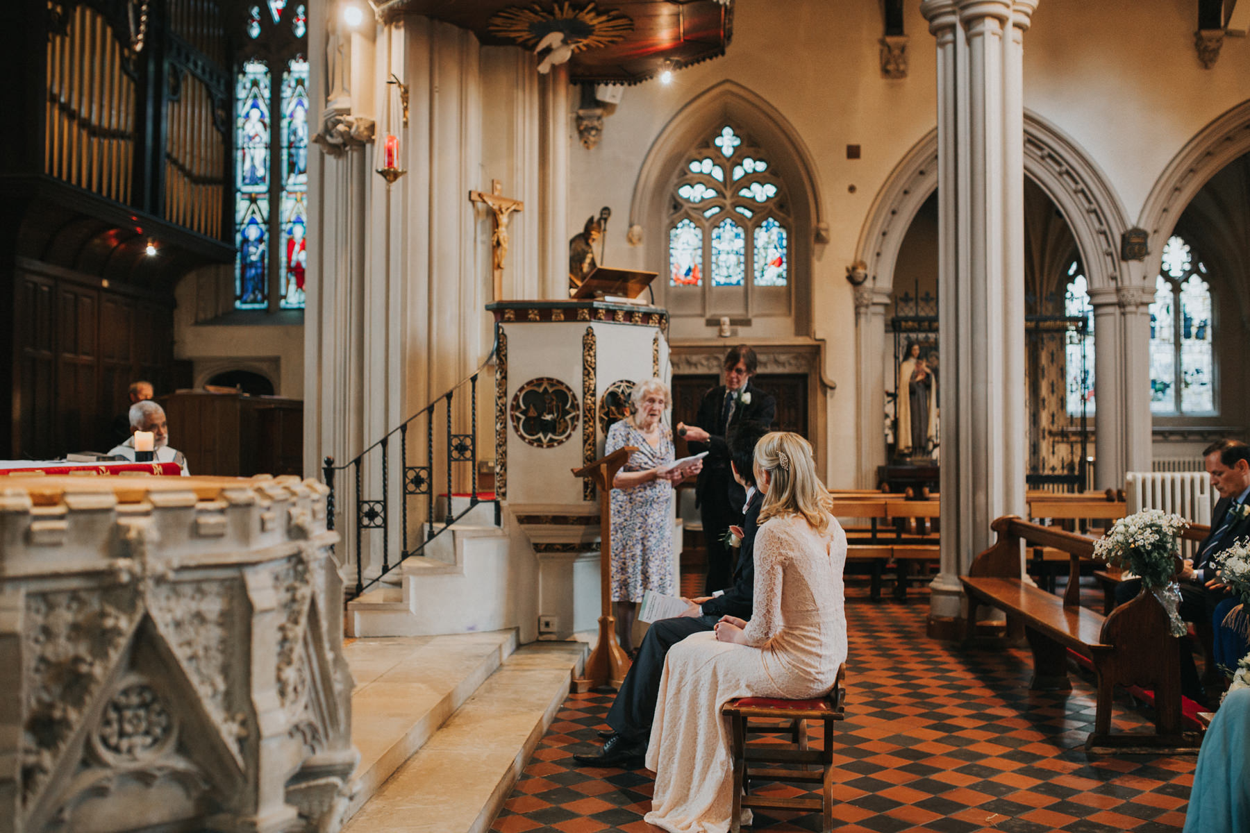 LD-194-London-wedding-grandma-reading-during-ceremony.jpg