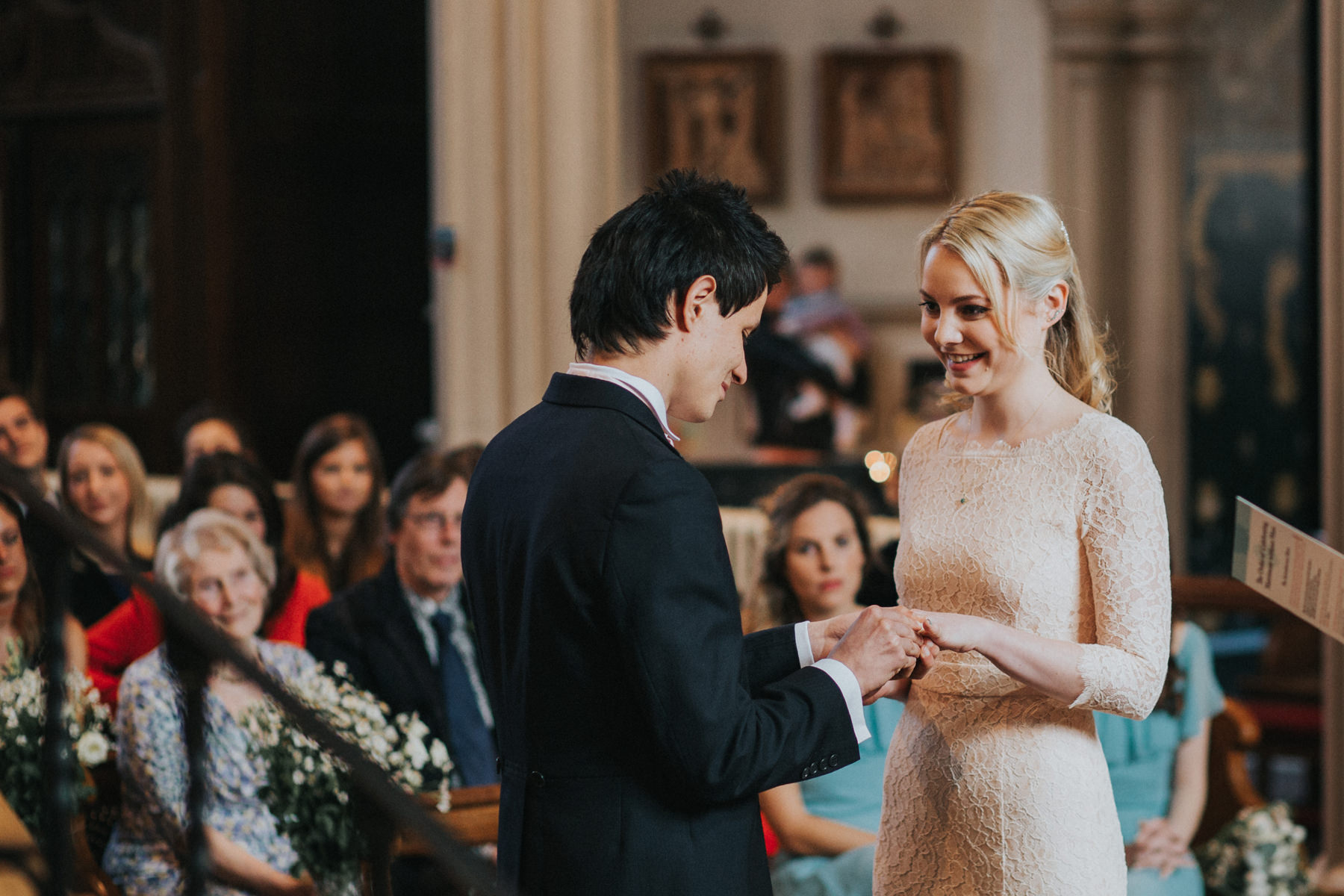 LD-237-catholic-marriage-ceremony-London-bride-groom-exchanging-rings-photography.jpg