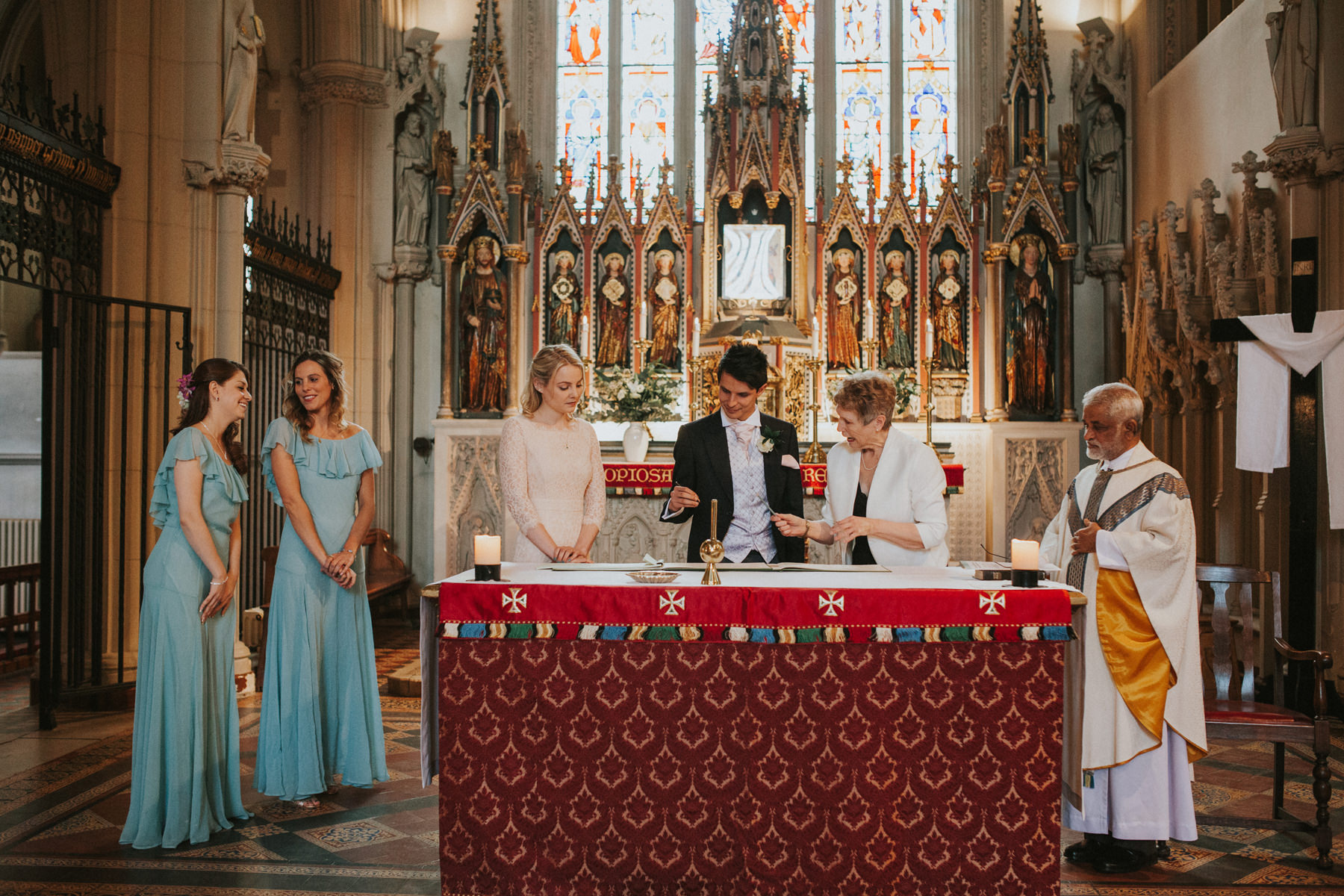 LD-257-catholic-church-signing-register-St-Marys-London-wedding-photographer.jpg