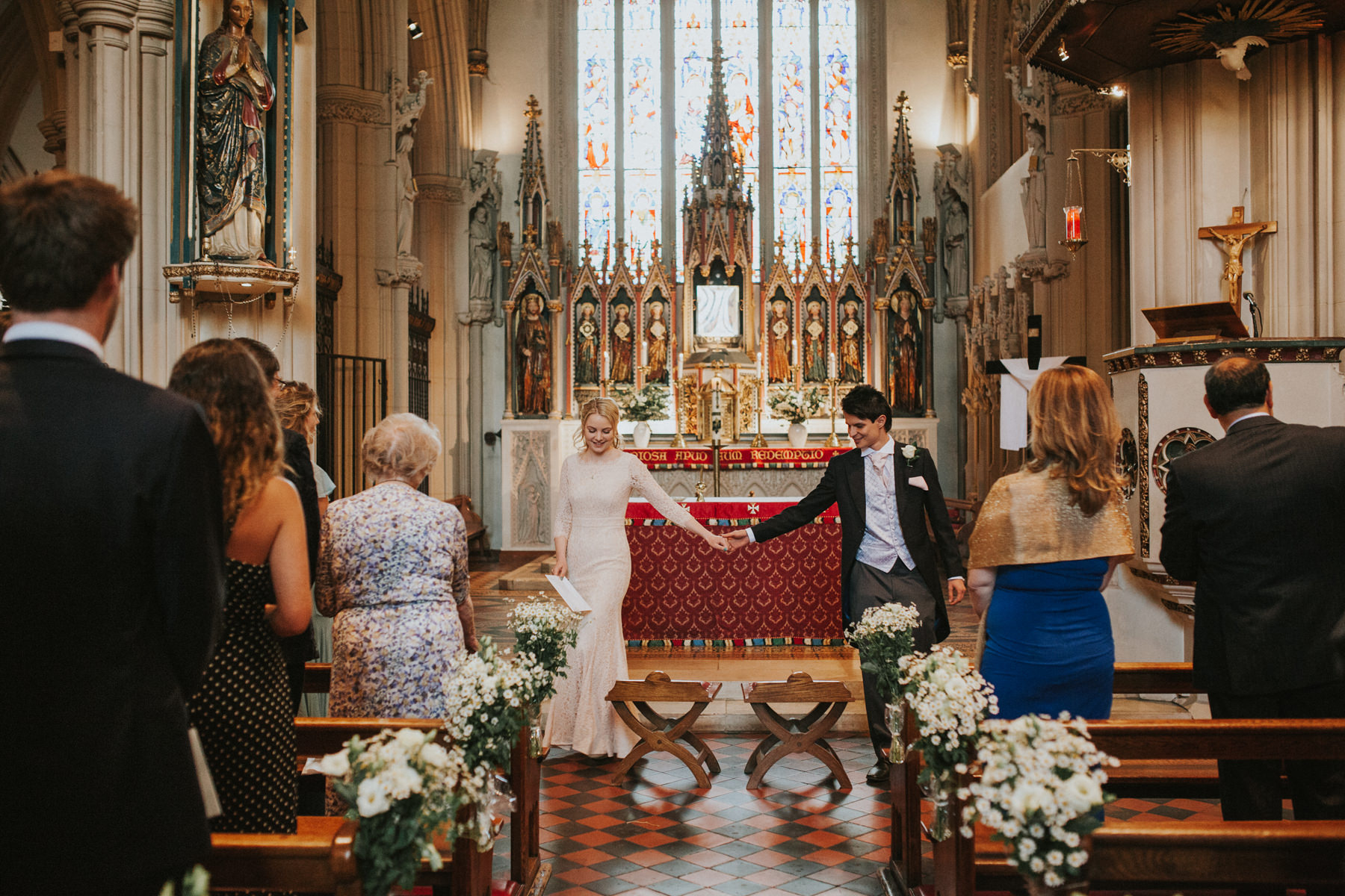 LD-281-bride-groom-coming-down-aisle-St-mary's-catholic-church-wedding-photographer.jpg