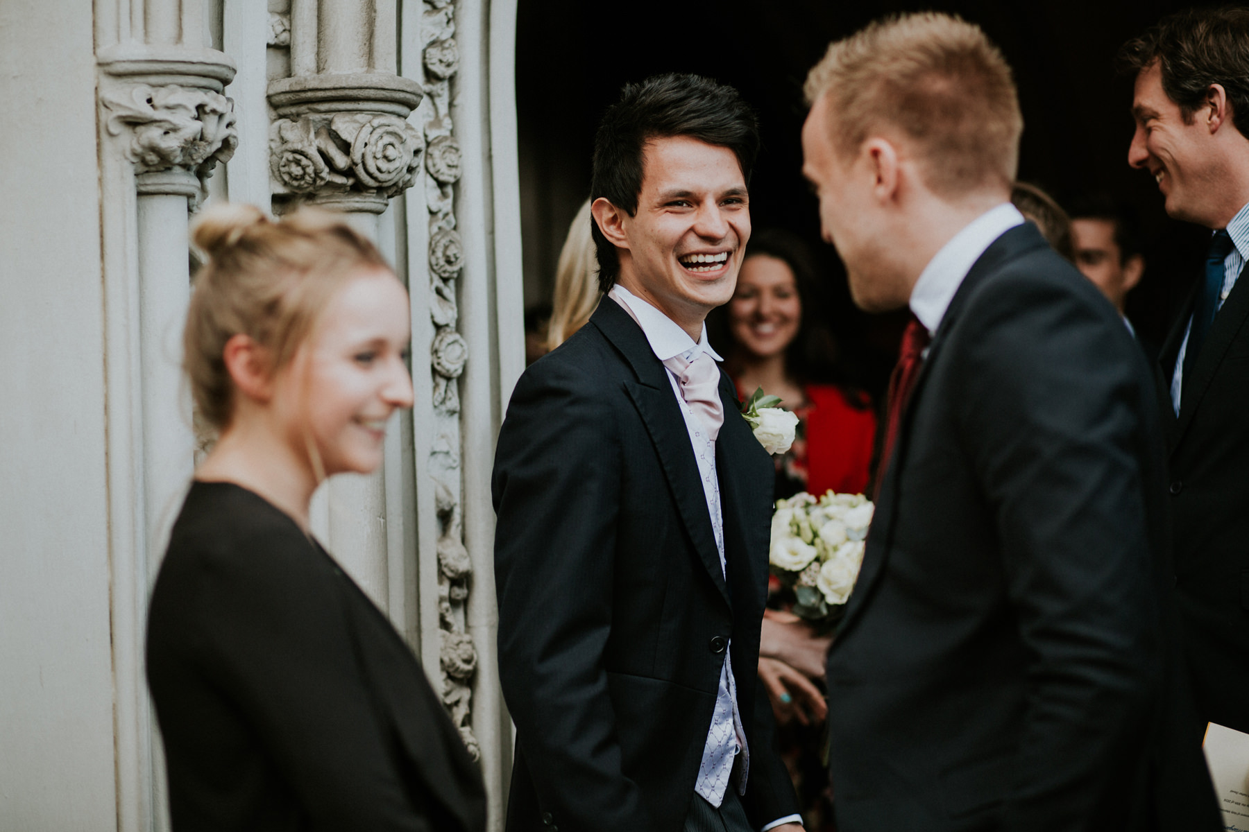 LD-324-groom-laughing-outside-church-London.jpg