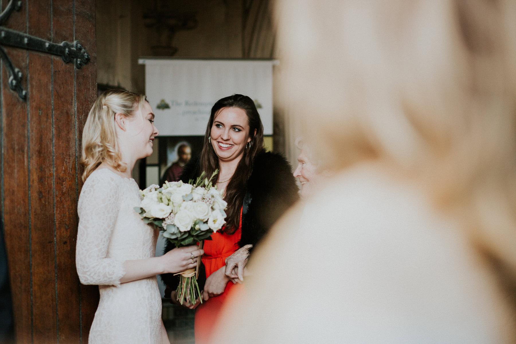 LD-345-guest-candids-outside-St-Marys-Clapham-London-reportage-wedding.jpg