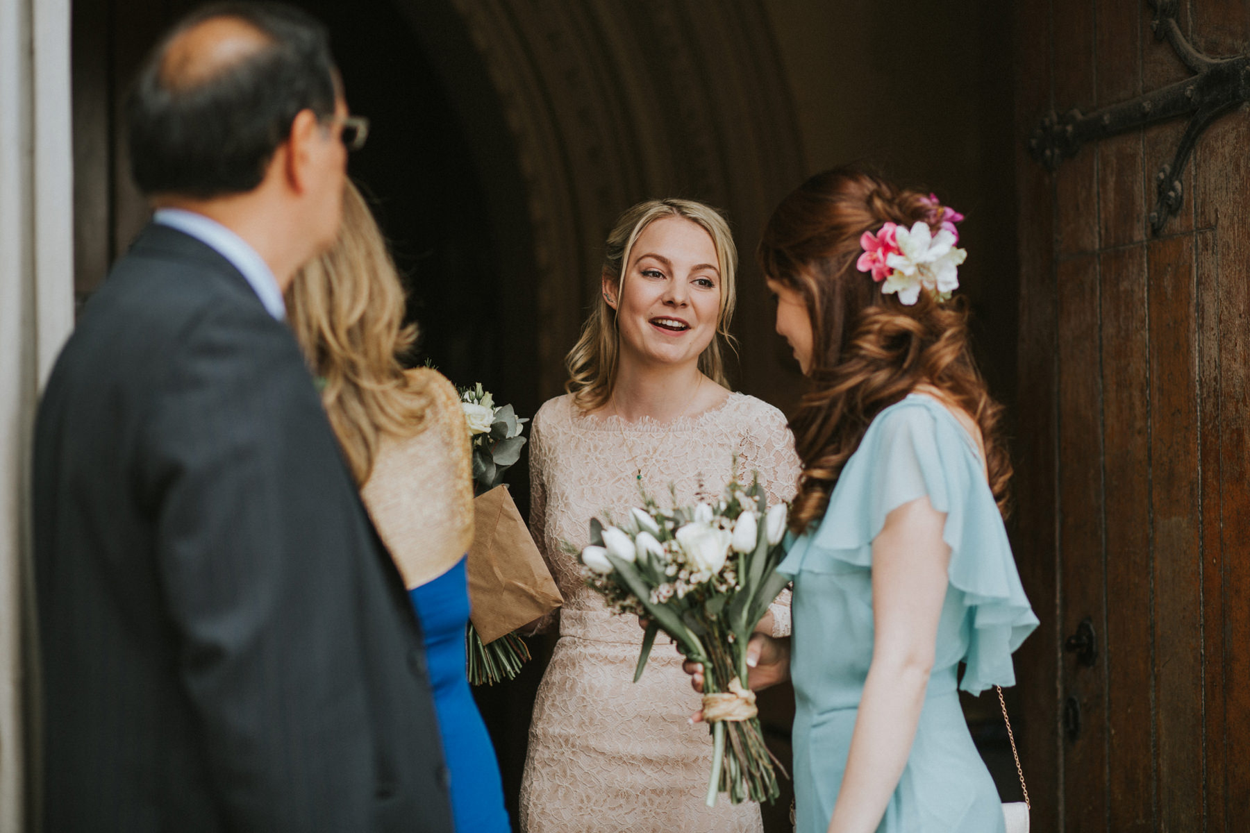 LD-357-bridal-party-candids-outside-St-Marys-Clapham-London-reportage-wedding.jpg