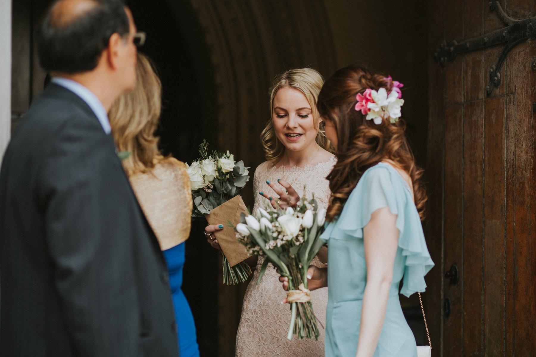 LD-356-guest-candids-outside-St-Marys-Clapham-London-reportage-wedding.jpg