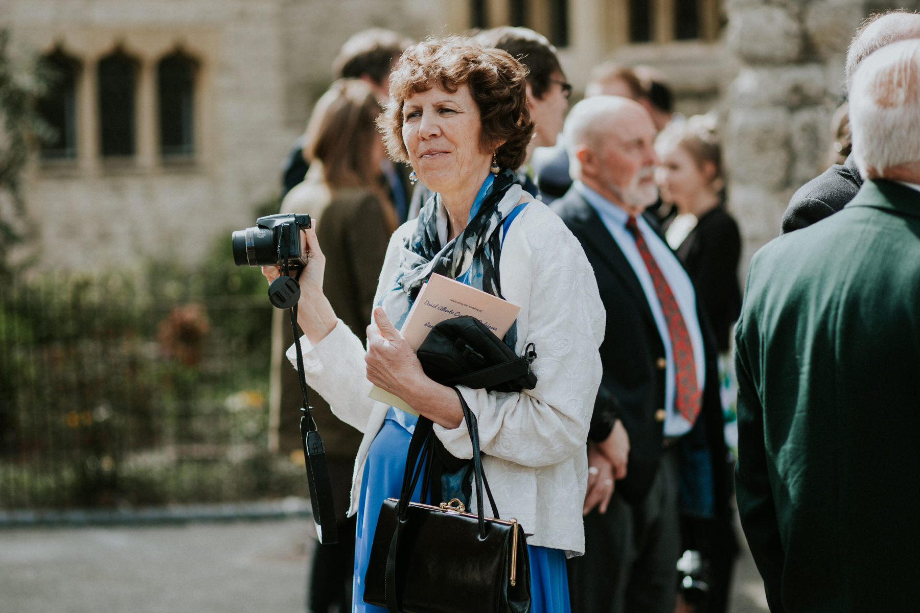 LD-361-guest-candids-outside-St-Marys-Clapham-London-reportage-wedding.jpg