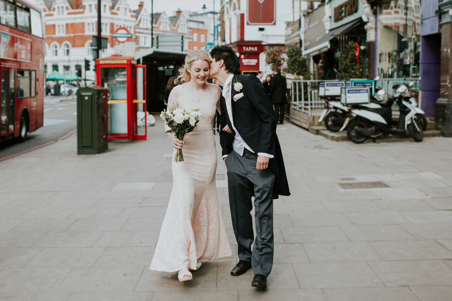 LD-378-newly-married-bride-groom-walking-London-street-photos.jpg