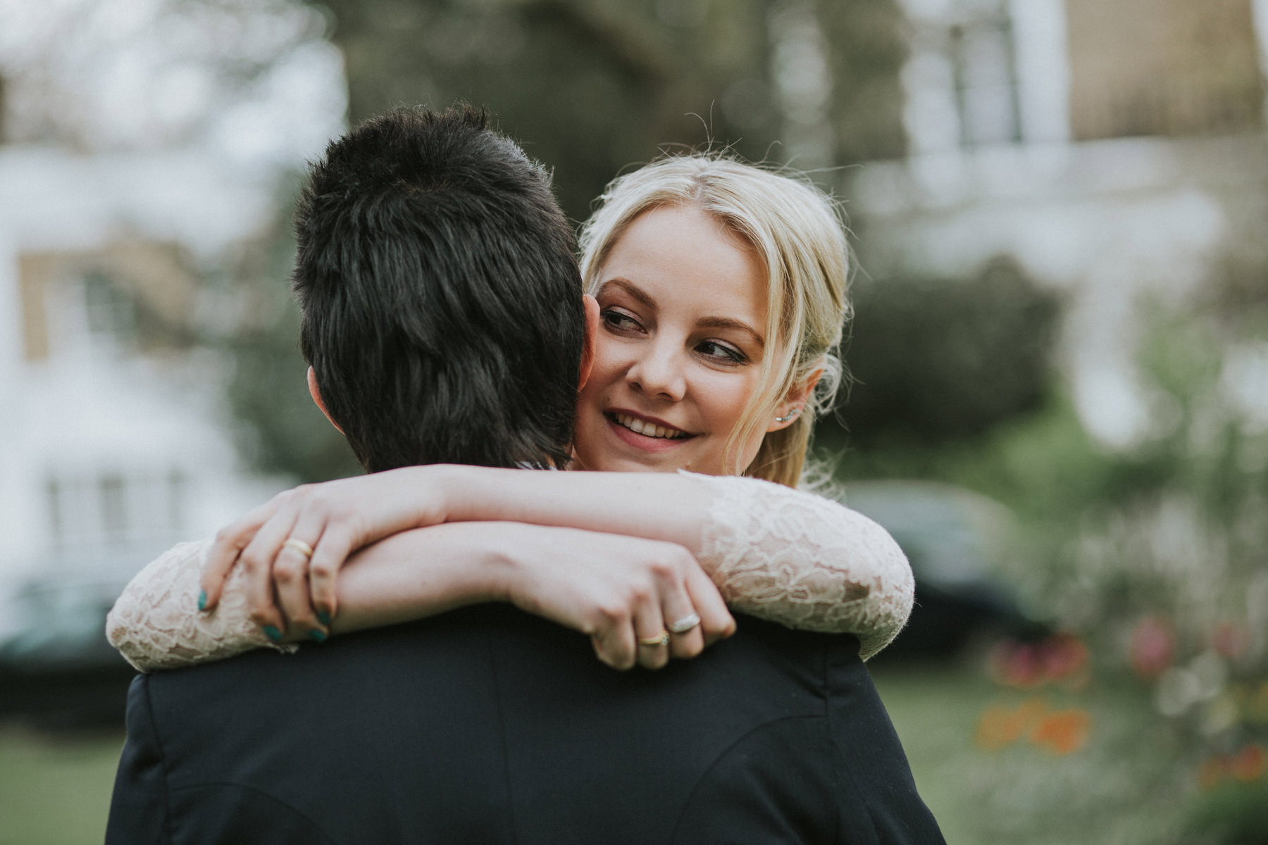LD-490-bride-groom-hugging-during-couple-portraits-session-clapham-London-alternative-reportage-wedding-photographer.jpg