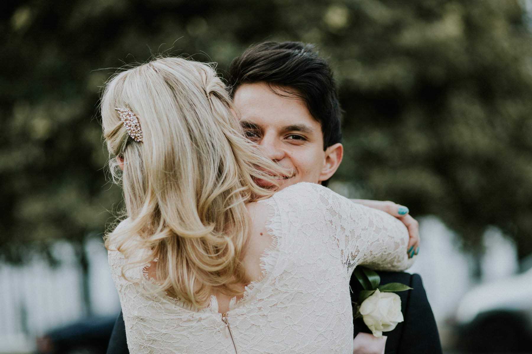 LD-494-bride-groom-hugging-during-couple-portraits-session-clapham-London-alternative-reportage-wedding-photographer.jpg