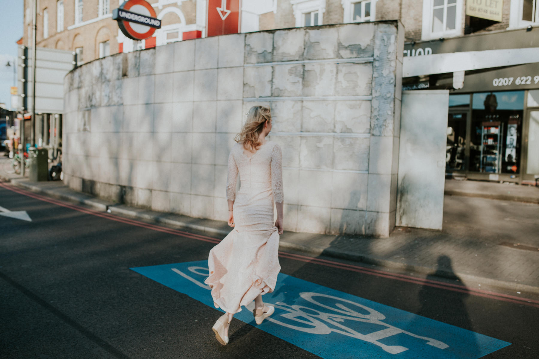 LD-681-bride-crossing-road-Clapham-common-London-wedding-photographer.jpg