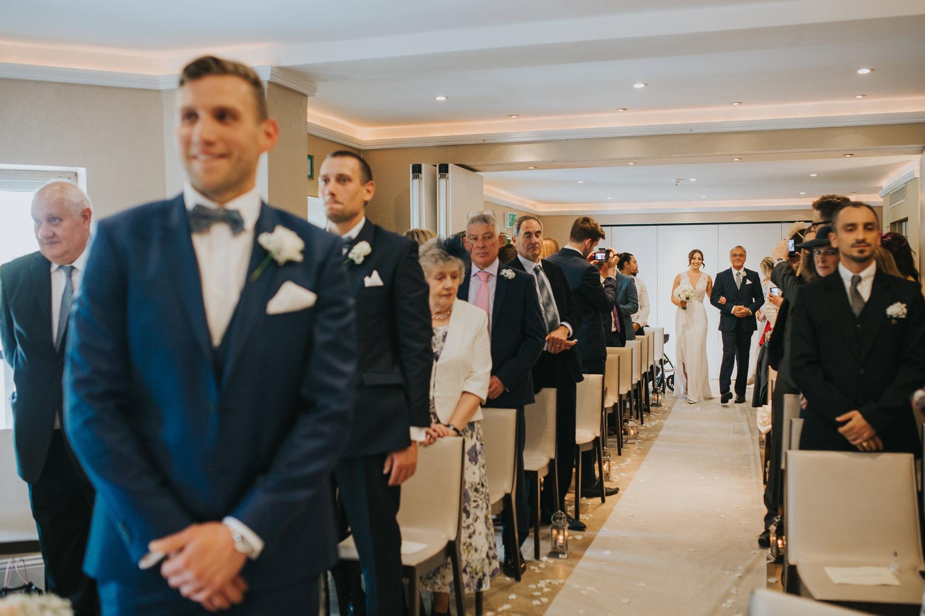 The Bingham Wedding Photographer London--groom waiting bride coming down aisle-CRL-125.jpg
