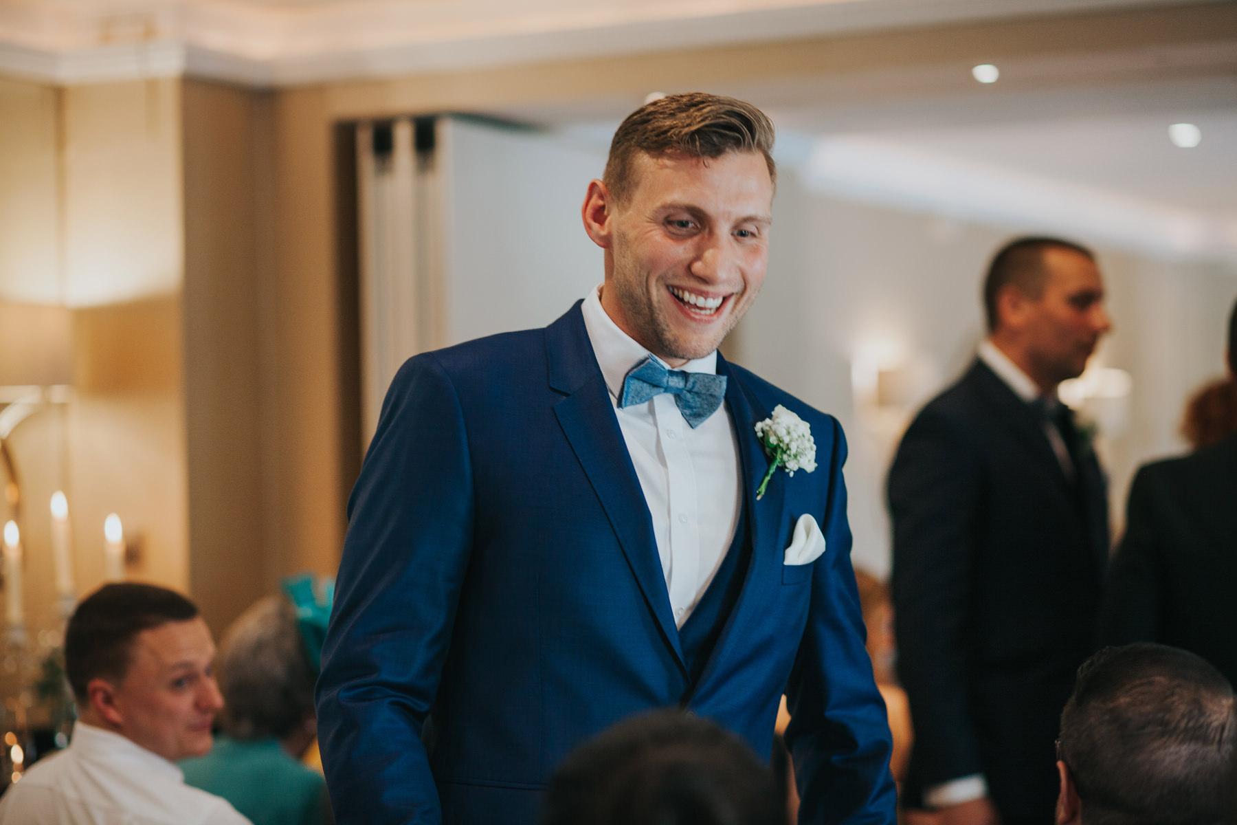 The Bingham Wedding Photographer London--groom waiting with guests ceremony room-CRL-102.jpg