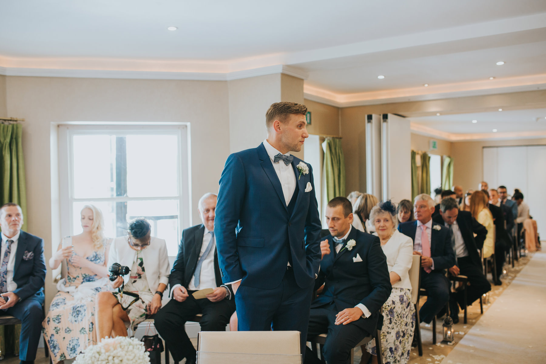 The Bingham Wedding Photographer London--groom waiting with guests ceremony room-CRL-107.jpg