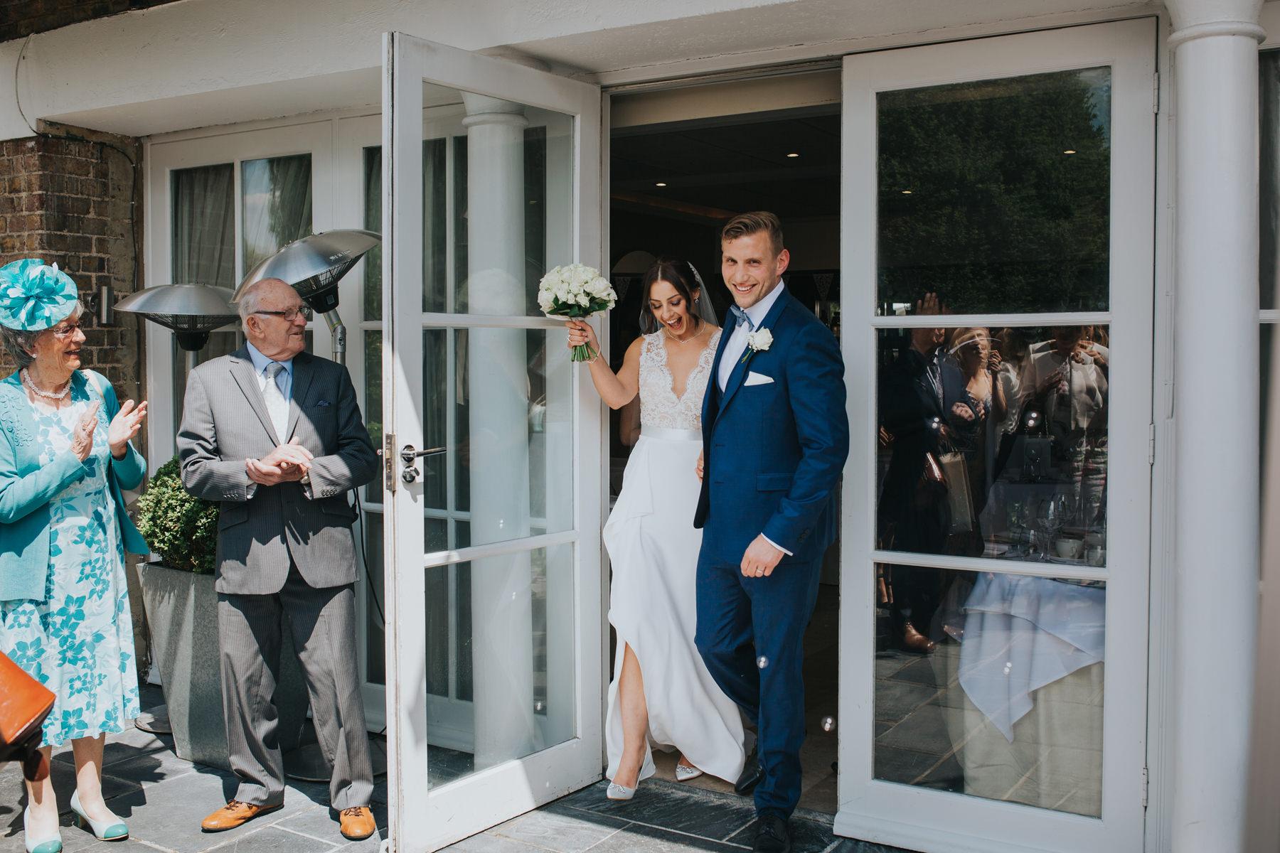 CRL-220-The Bingham Wedding Richmond-groom bride guests blowing bubbles.jpg