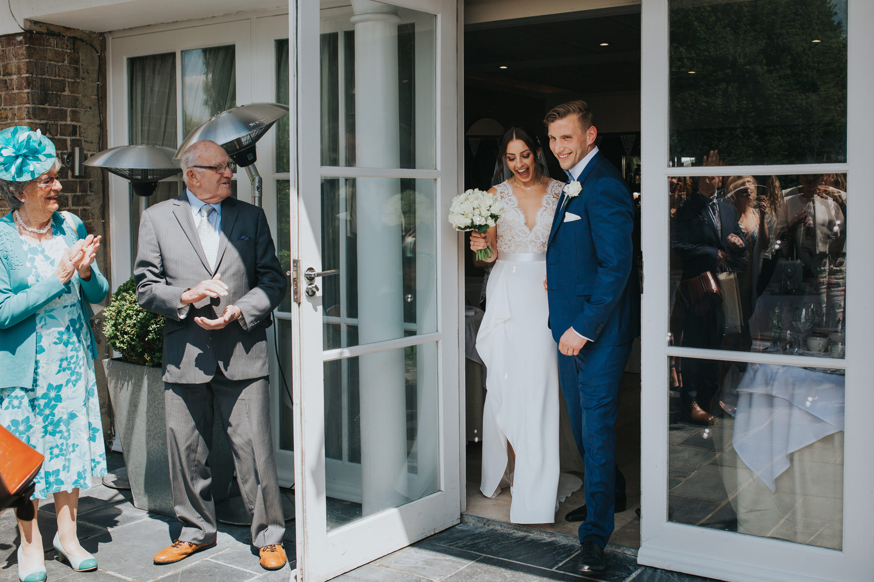 CRL-219-The Bingham Wedding Richmond-groom bride guests blowing bubbles.jpg