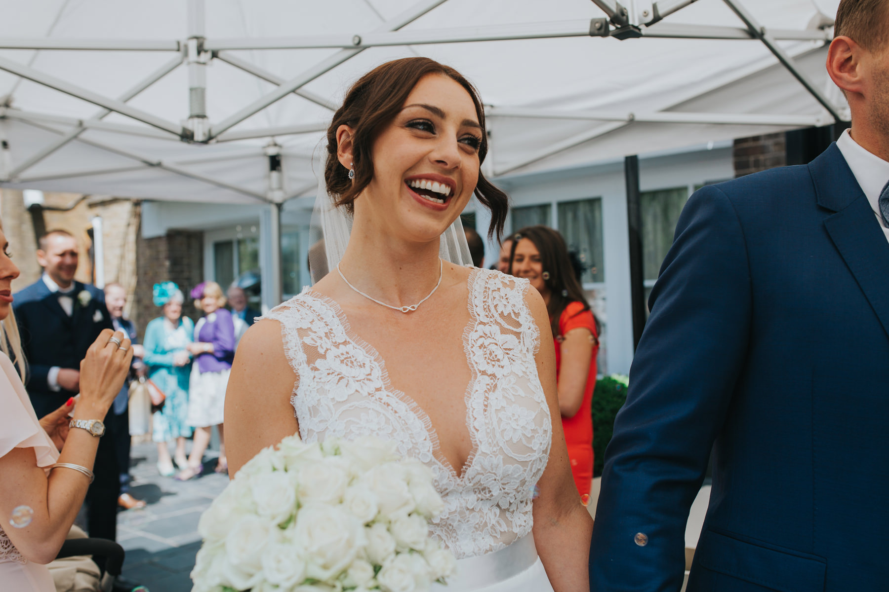 CRL-227-The Bingham Wedding Richmond-groom bride guests blowing bubbles.jpg