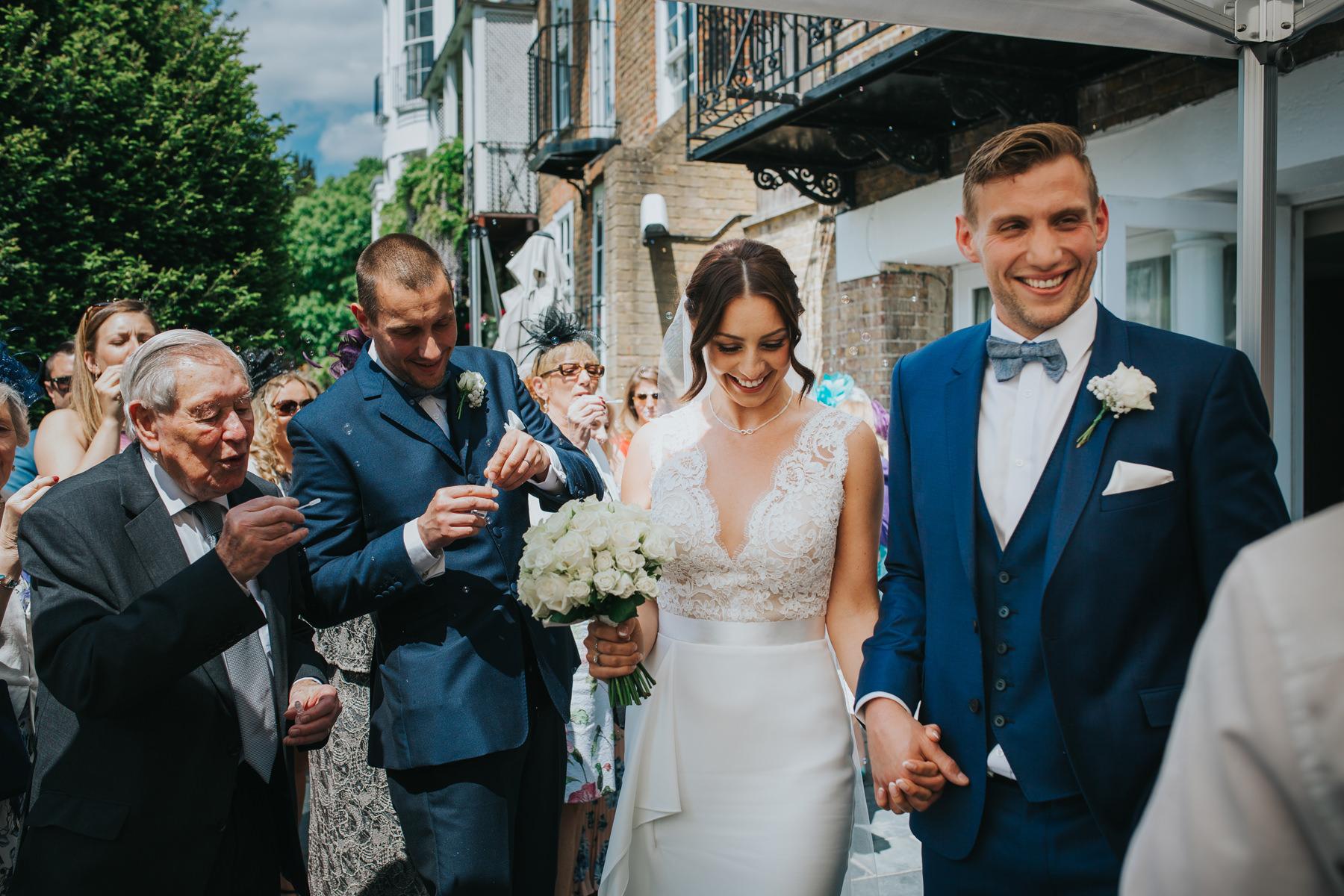 CRL-224-The Bingham Wedding Richmond-groom bride guests blowing bubbles.jpg