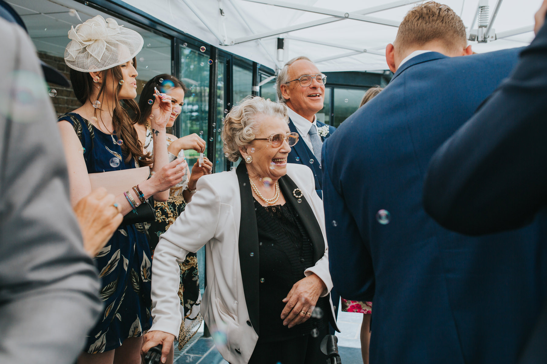 CRL-230-The Bingham Wedding Richmond-groom bride guests blowing bubbles.jpg