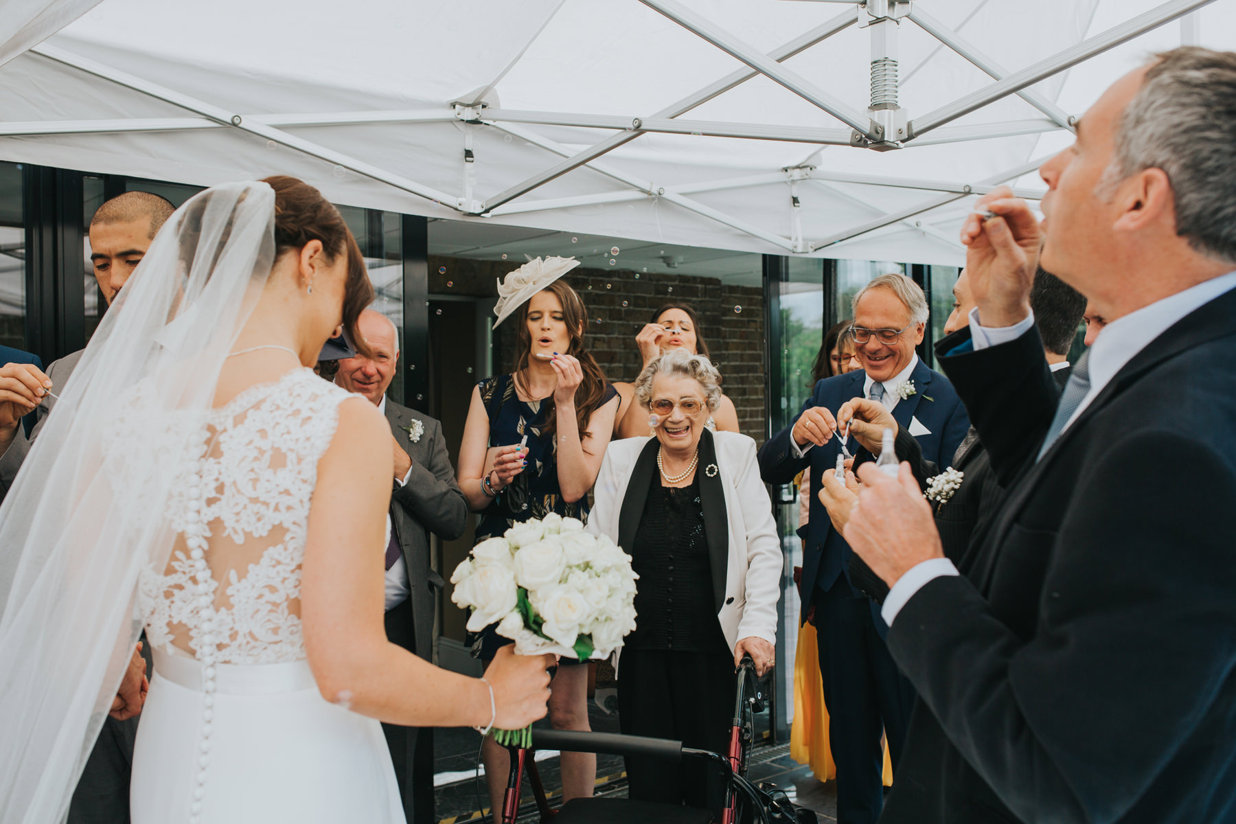 CRL-229-The Bingham Wedding Richmond-groom bride guests blowing bubbles.jpg
