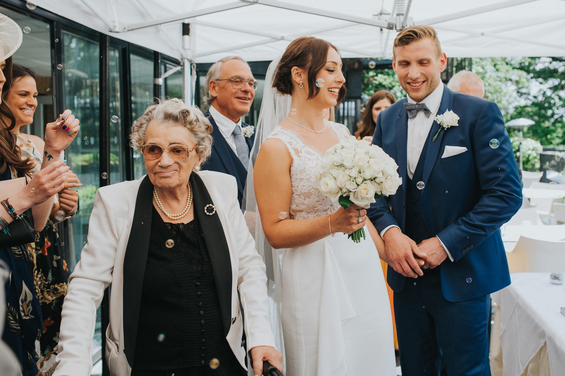 CRL-232-The Bingham Wedding Richmond-groom bride guests blowing bubbles.jpg