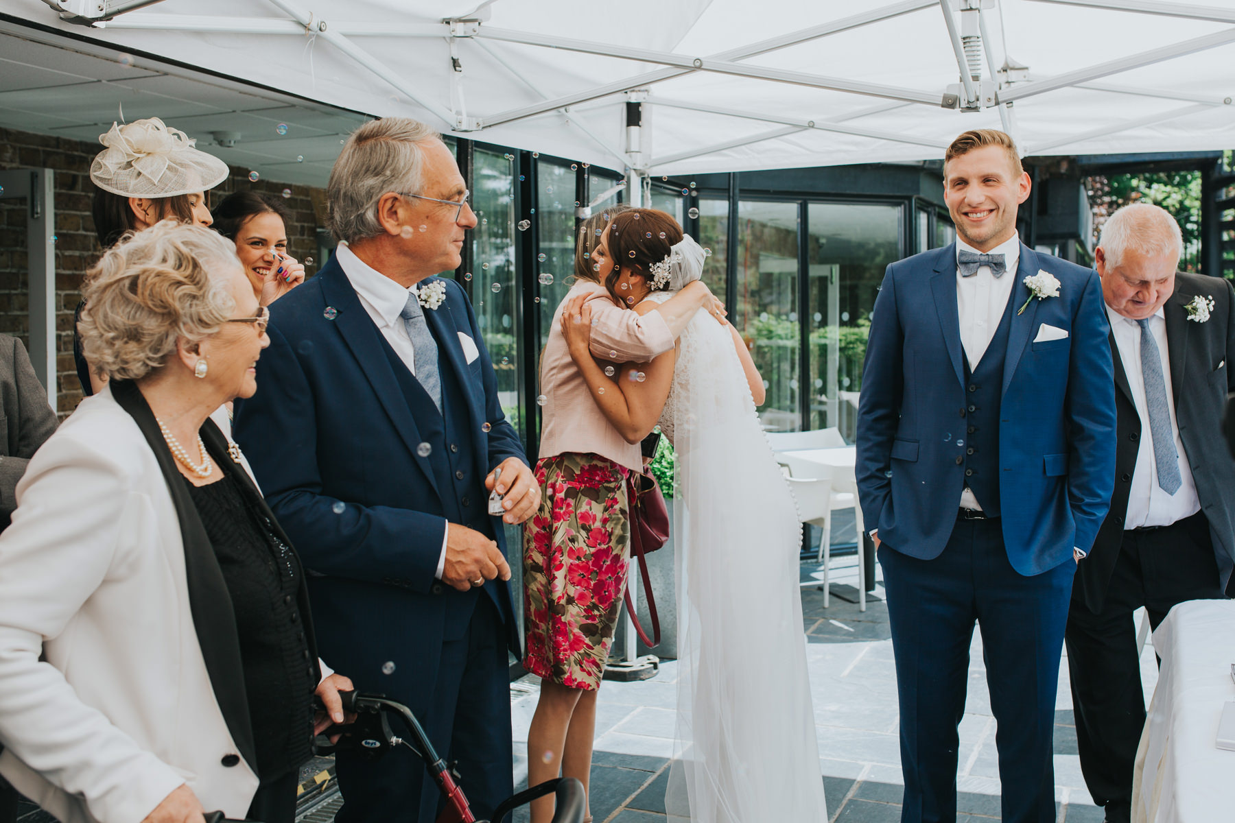 CRL-235-The Bingham Wedding Richmond-groom bride guests blowing bubbles.jpg