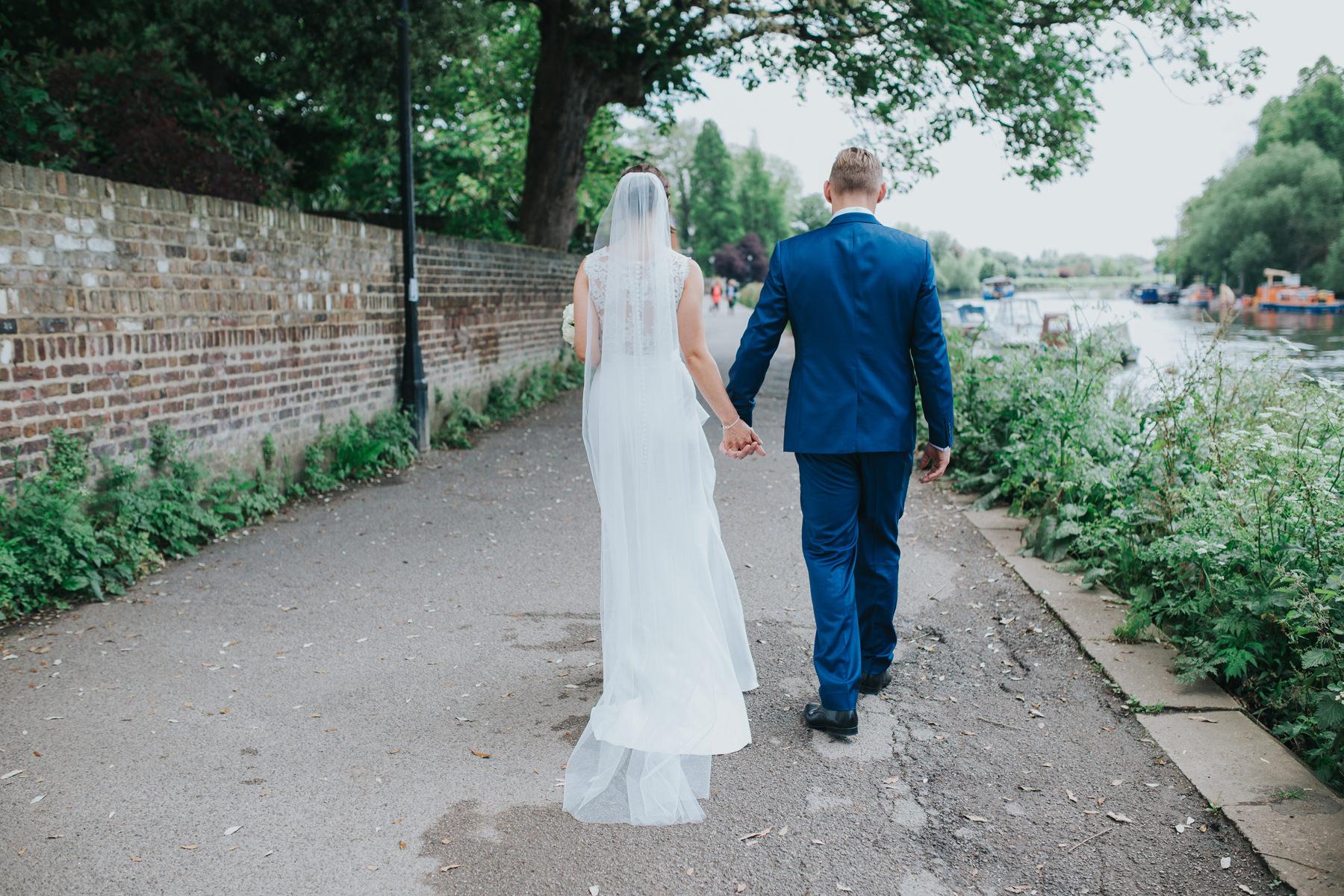 CRL-364-The Bingham wedding Richmond-Claire Rob bridal couple portraits on Thamespath.jpg