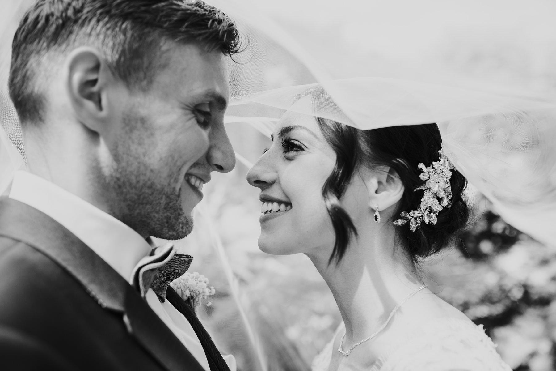 CRL-424-The Bingham wedding Richmond-Claire Rob wedding couple portraits veil shot.jpg