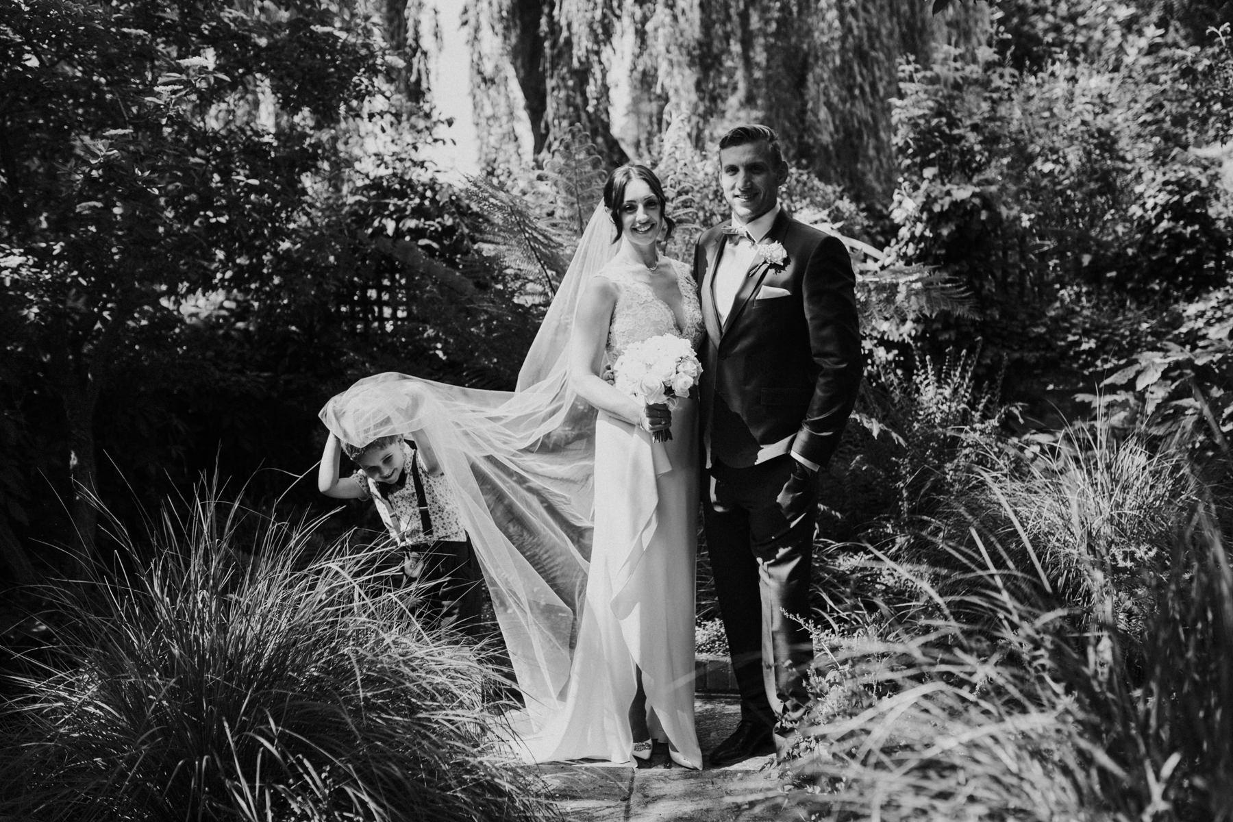 CRL-432-The Bingham wedding Richmond-Claire Rob wedding couple portraits veil shot.jpg