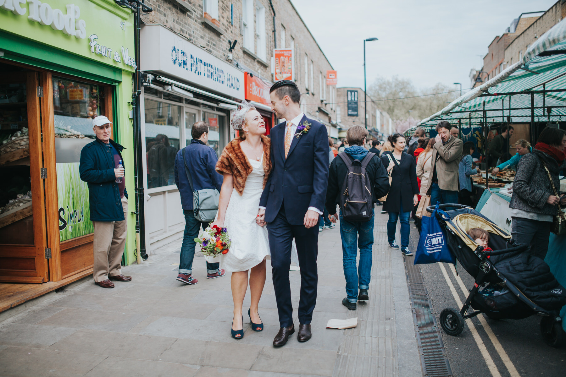 MS-Londesborough-Pub-wedding-Hackney-alternative-photographer-17-Broadway-market-wedding-photos-groom-holding-hands-bride.jpg