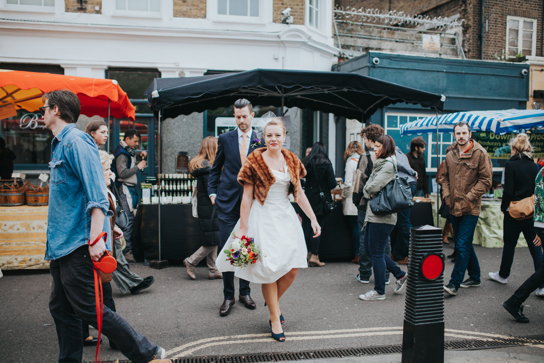 bride wearing Vivienne Westwood dress Broadway Market reportage wedding