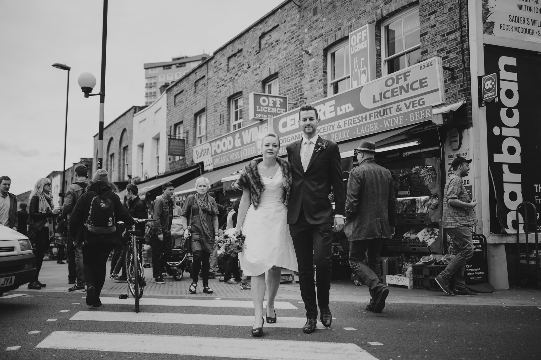 MS-Londesborough-Pub-wedding-Hackney-alternative-photographer-37-wedding-portraits-Broadway-market-quirky-couple-crossing-road.jpg