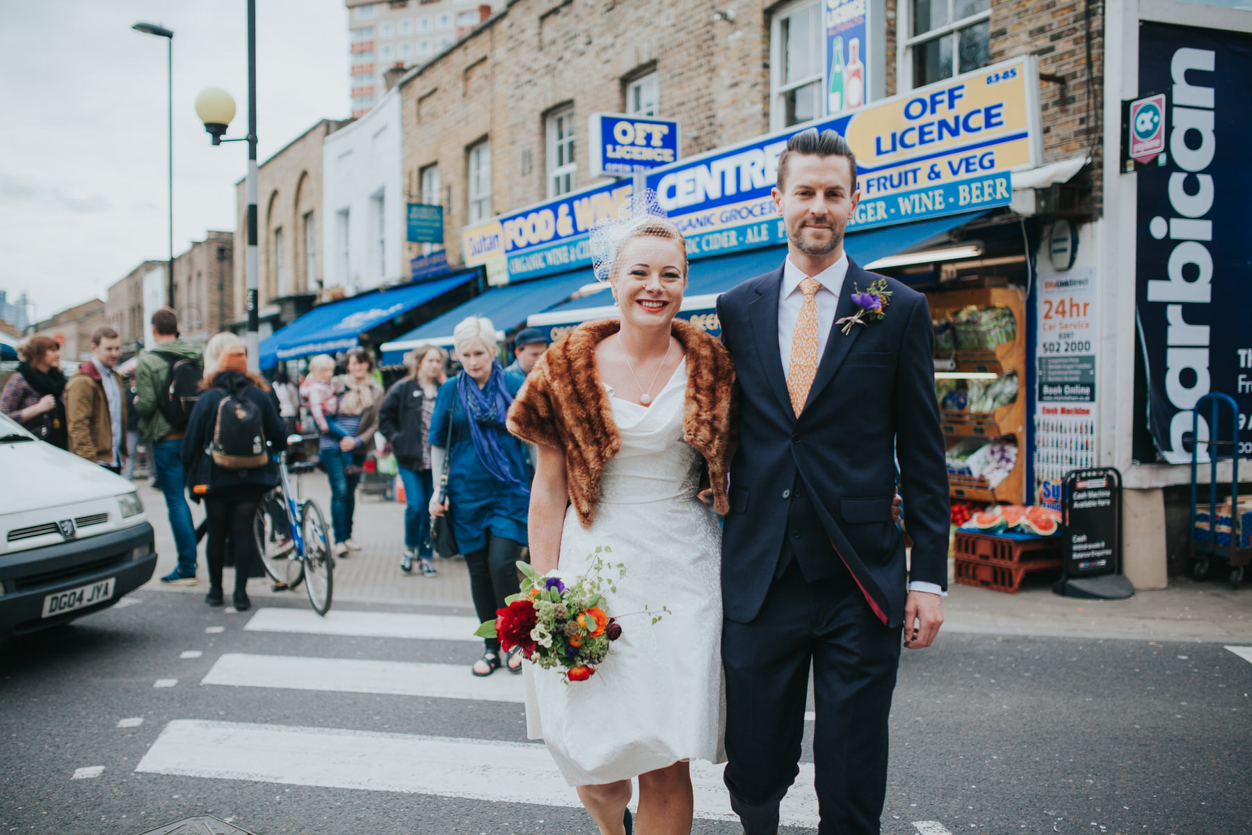 MS-Londesborough-Pub-wedding-Hackney-alternative-photographer-38-wedding-portraits-Broadway-market-quirky-couple-crossing-road.jpg