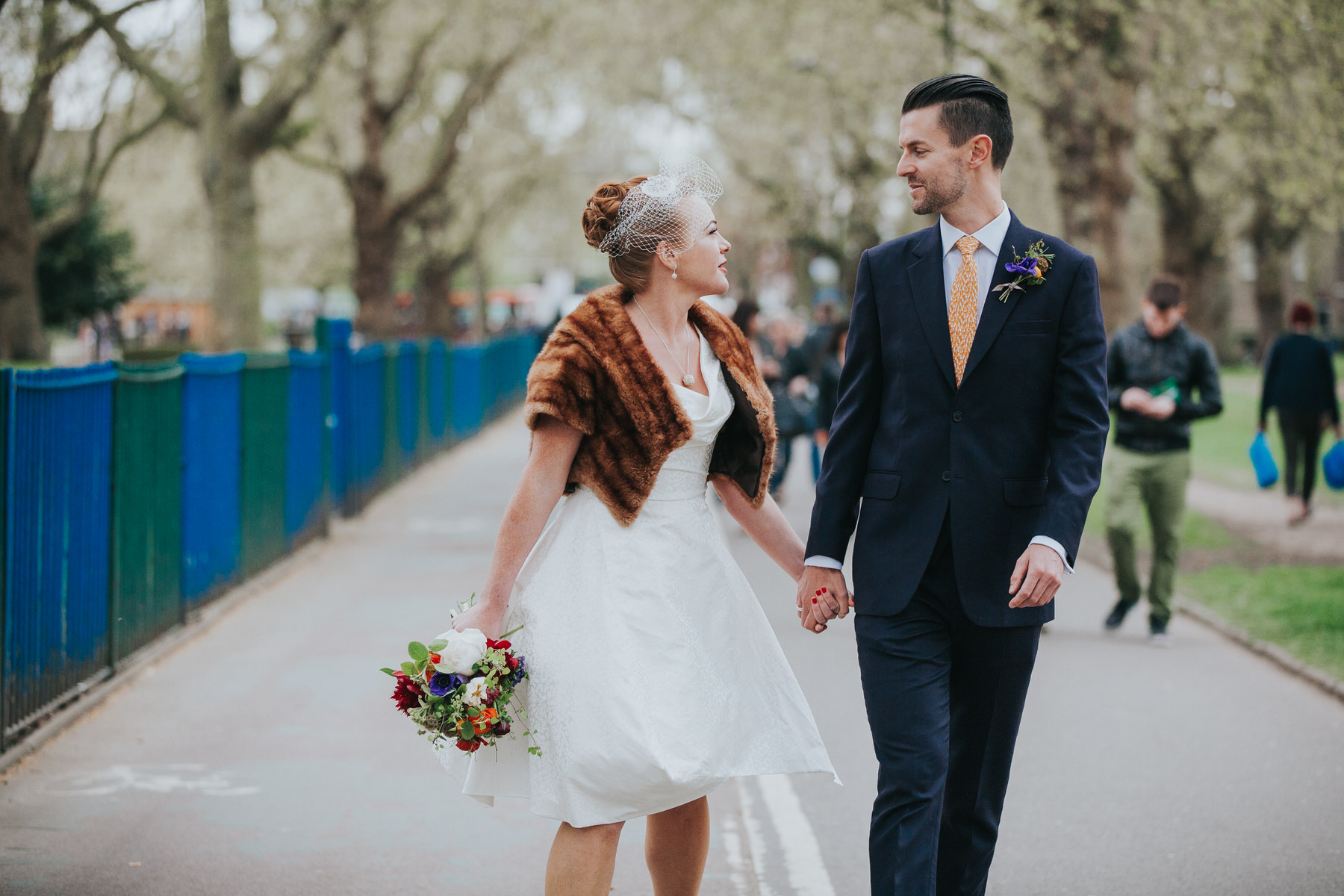 MS-Londesborough-Pub-wedding-Hackney-alternative-photographer-45-wedding-photo-quirky-groom-bride-holding-hands-London-Fields-reportage.jpg