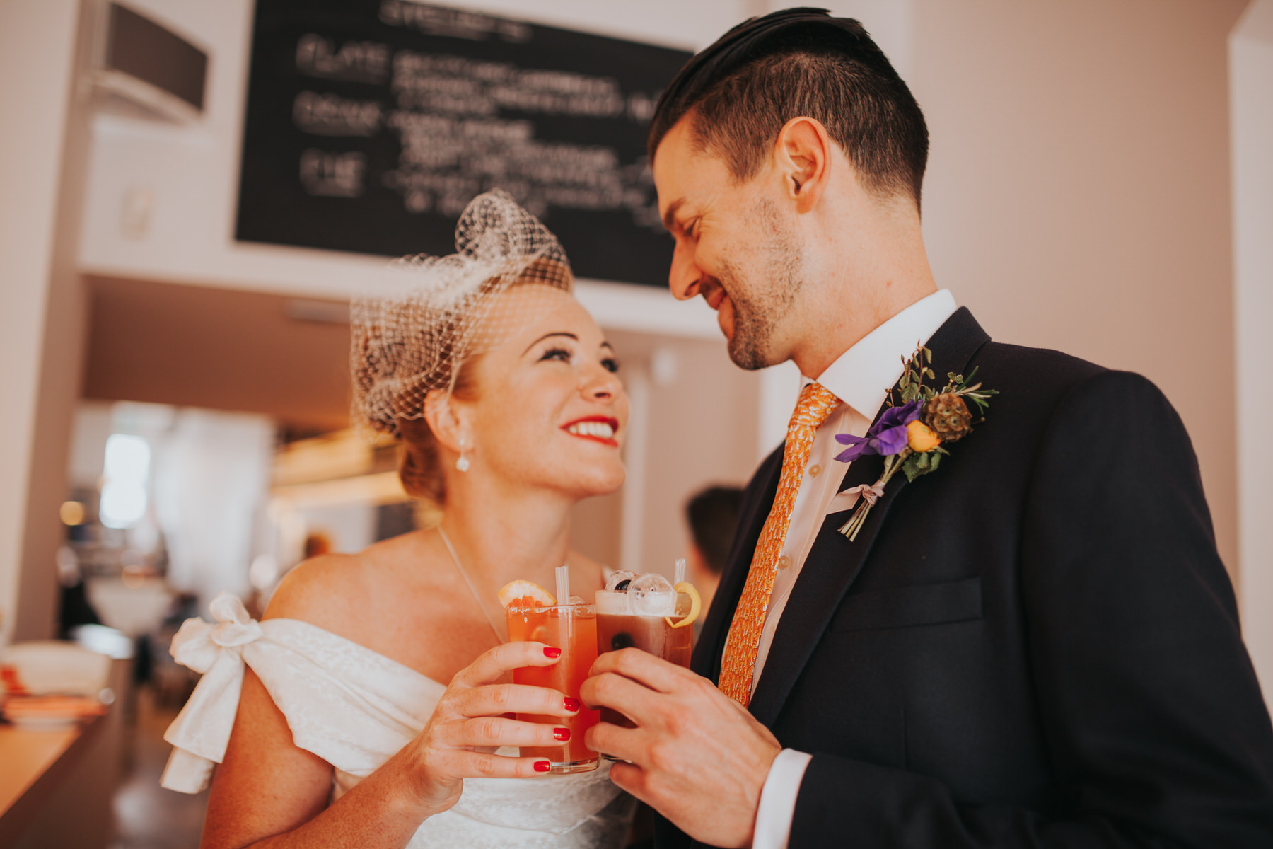 MS-Londesborough-Pub-wedding-Hackney-alternative-photographer-66-bride-drinking-cocktails-Ritas-London.jpg