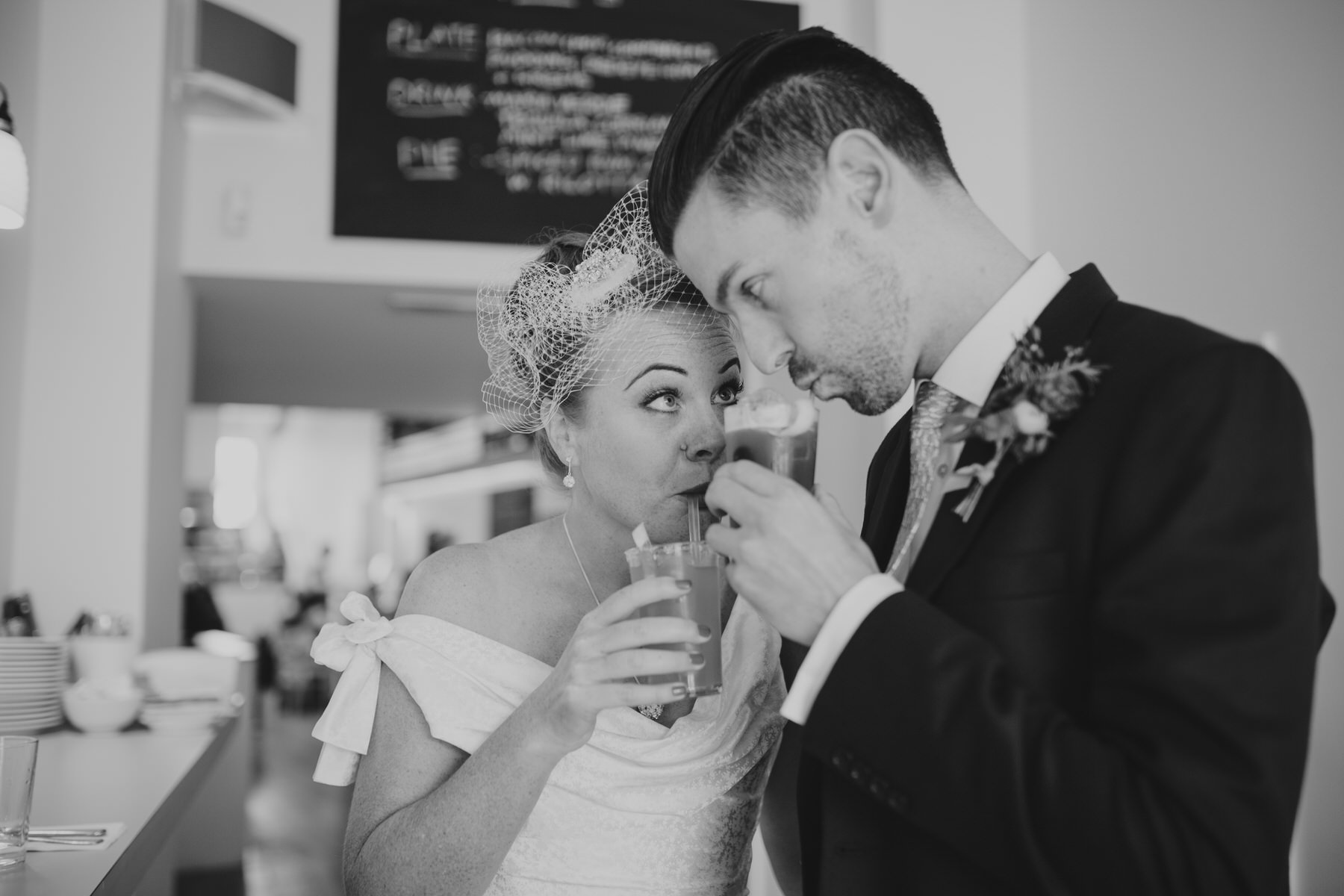 MS-Londesborough-Pub-wedding-Hackney-alternative-photographer-67-BW-bride-drinking-cocktails-Ritas-London.jpg