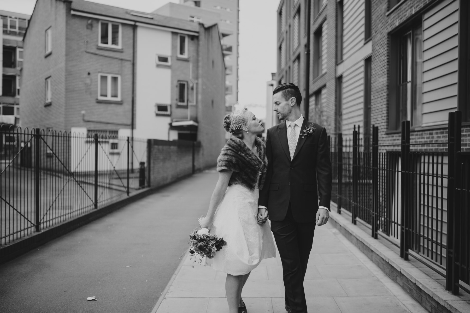 MS-Londesborough-Pub-wedding-Hackney-alternative-photographer-84-last-minute-kiss-bride-groom-before-unplugged-ceremony.jpg