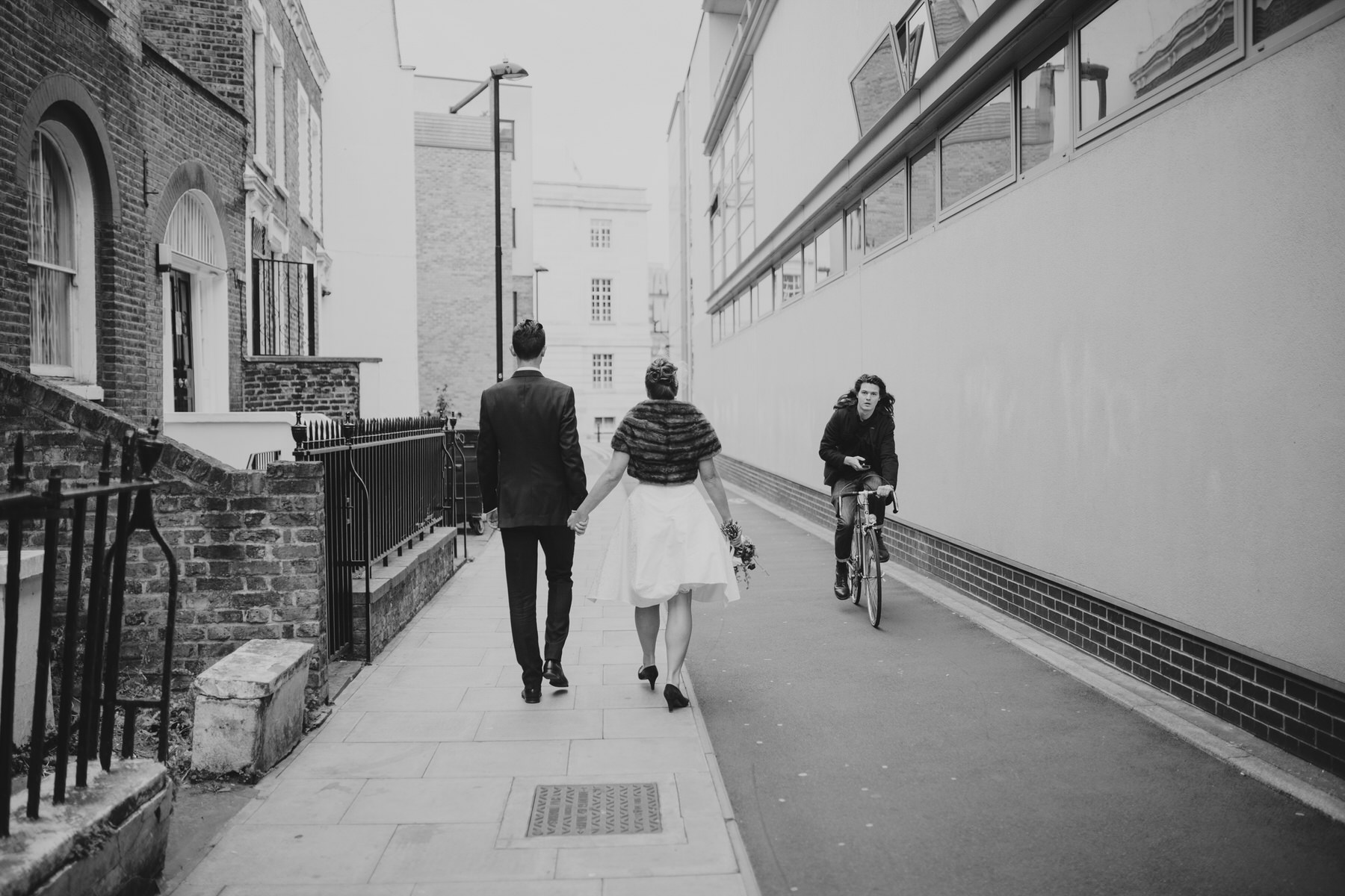 MS-Londesborough-Pub-wedding-Hackney-alternative-photographer-85-reportage-wedding-photographer-London-couple-walking.jpg