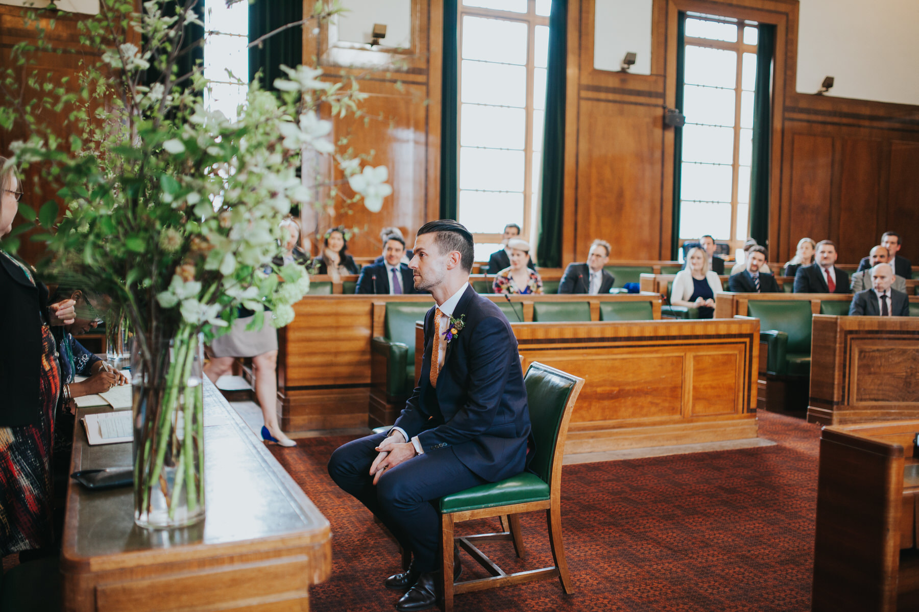 MS-Londesborough-Pub-wedding-Hackney-alternative-photographer-98-groom-waiting-bride-London-town-hall-council-chamber.jpg