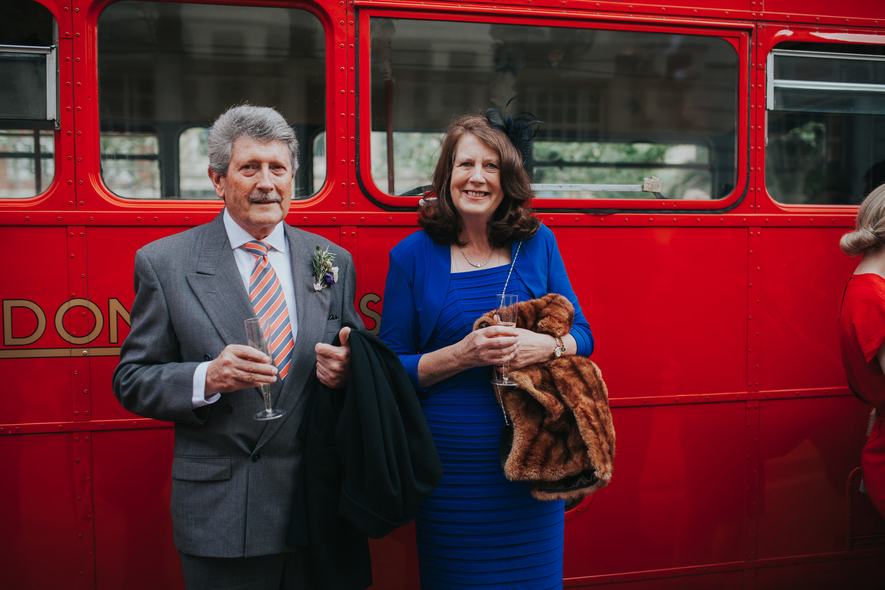 MS-Londesborough-Pub-wedding-Hackney-alternative-photographer-135-guests-drinking-bubbly-red-london-wedding-bus.jpg